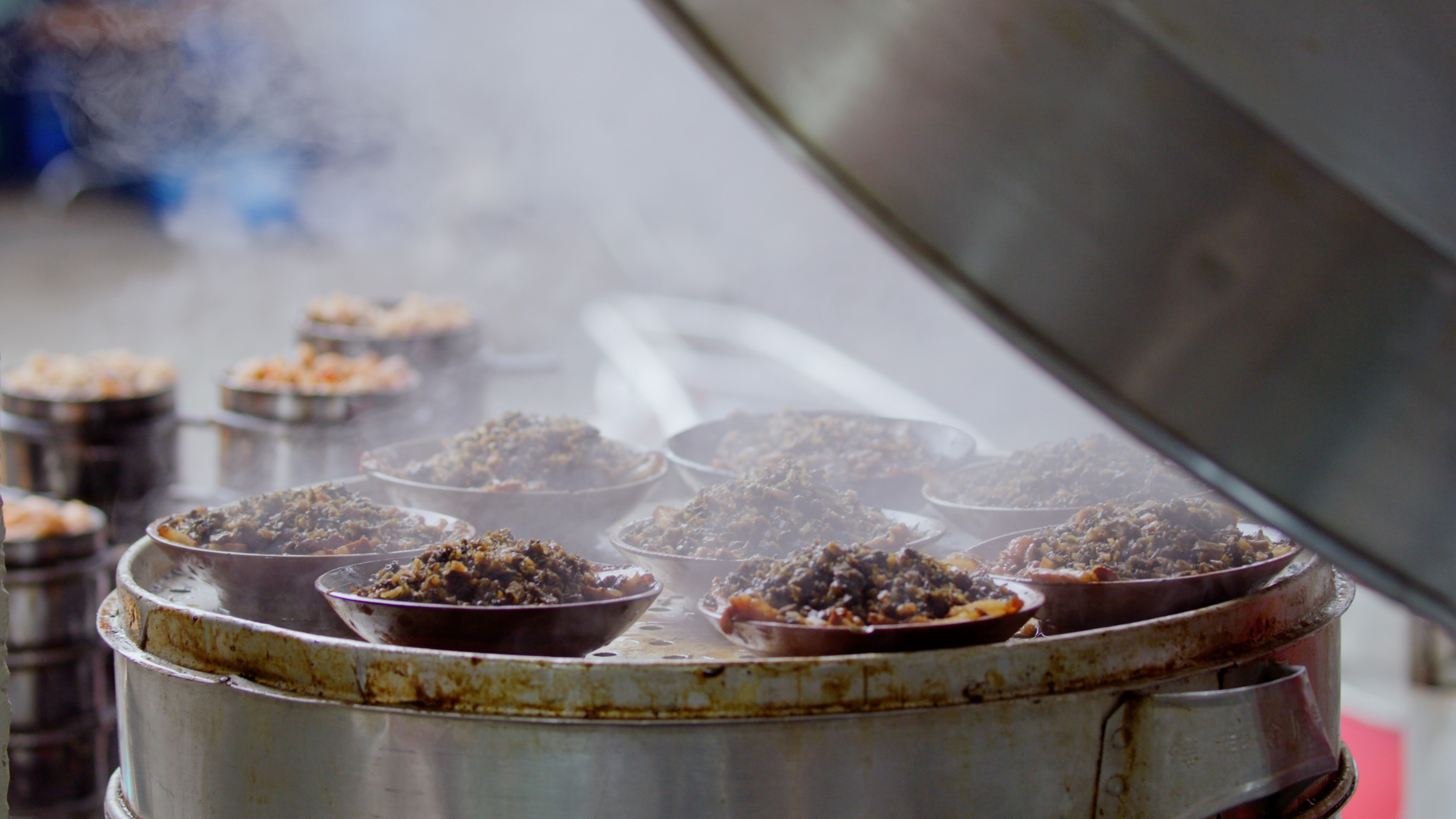 In this still taken from Season 2 of the series Once Upon a Bite, which debuted on Apr. 26, 2020, dishes of braised pork rice from Sichuan, China are being steamed.