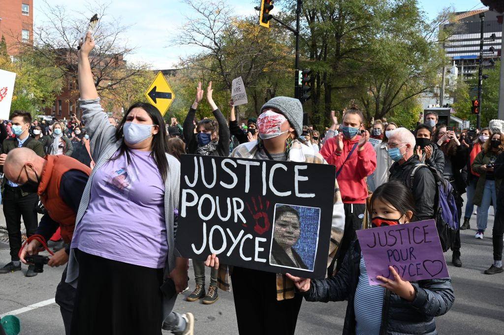 Protesters gather during a demonstration in central Montreal on October 3, 2020, to demand action for the death of Joyce Echaquan, a Canadian indigenous woman subjected to live-streamed racist slurs by hospital staff before her death.