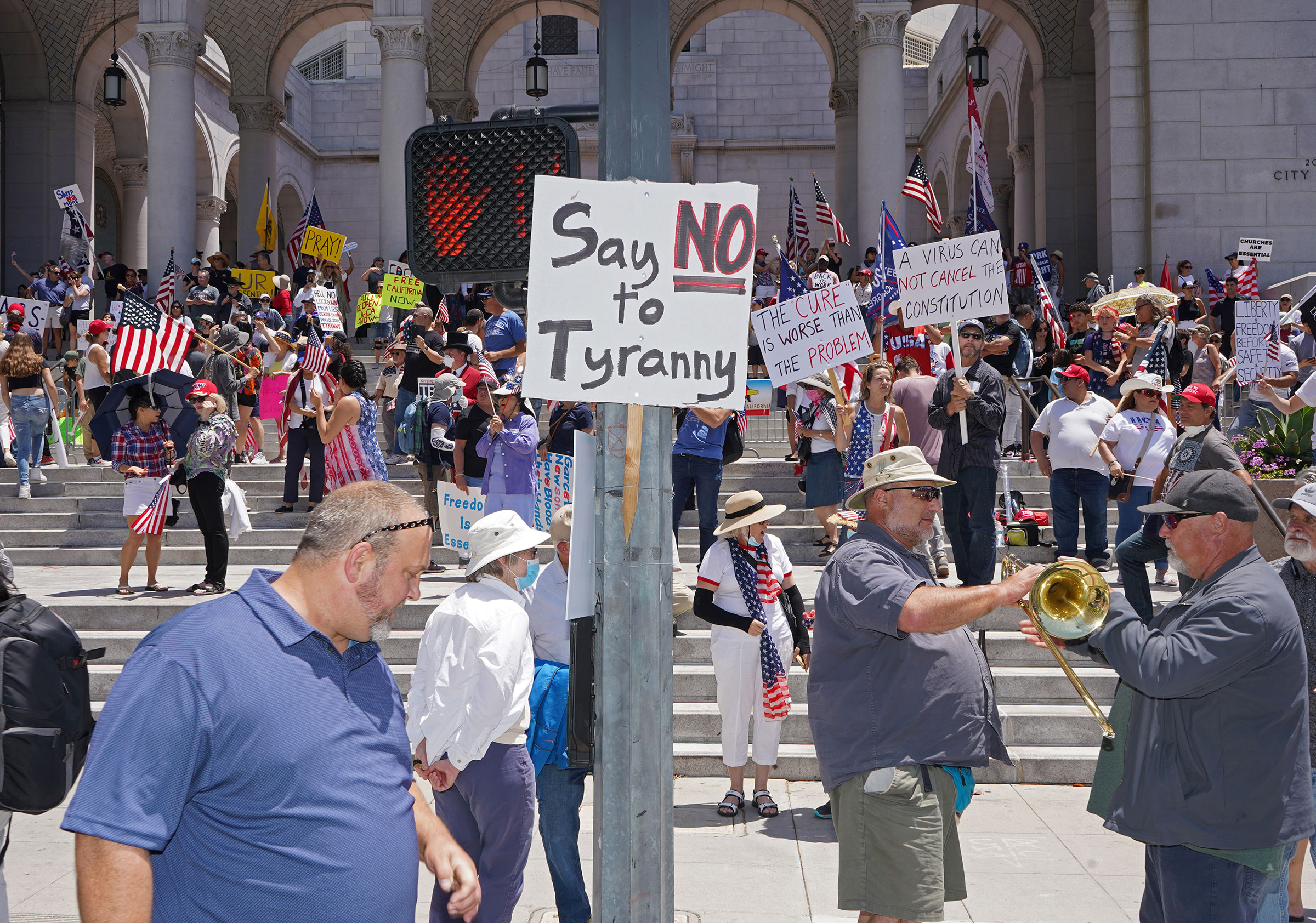 Protesters calling for a reopening of California from coronavirus lockdown measures and restrictions in front of City Hall in Los Angeles, May 24, 2020.