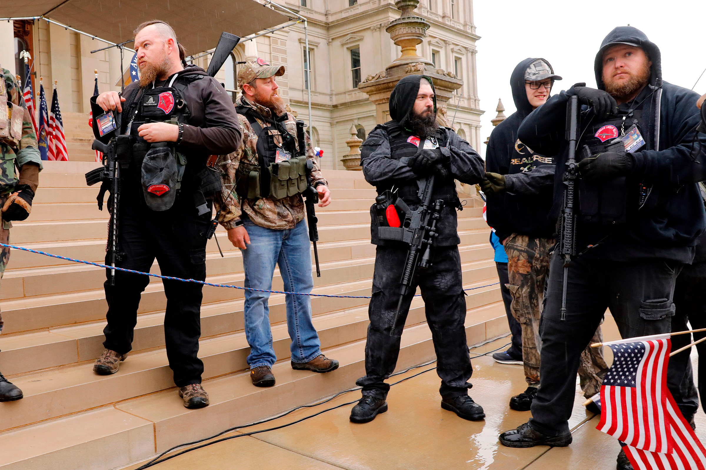 Michael Null (R) and William Null (L) arrive at the American Patriot Rally, to demand the reopening of businesses on the steps of the Michigan State Capitol in Lansing, Mich., on April 30, 2020. Thirteen men, including members of two right-wing militias, have been arrested for plotting to kidnap Michigan Gov. Gretchen Whitmer and  instigate a civil war , Michigan Attorney General Dana Nessel announced on October 8, 2020. The Nulls were charged for their alleged roles in the plot, according to the FBI. The brothers are charged with providing support for terroristic acts and felony weapons charges.