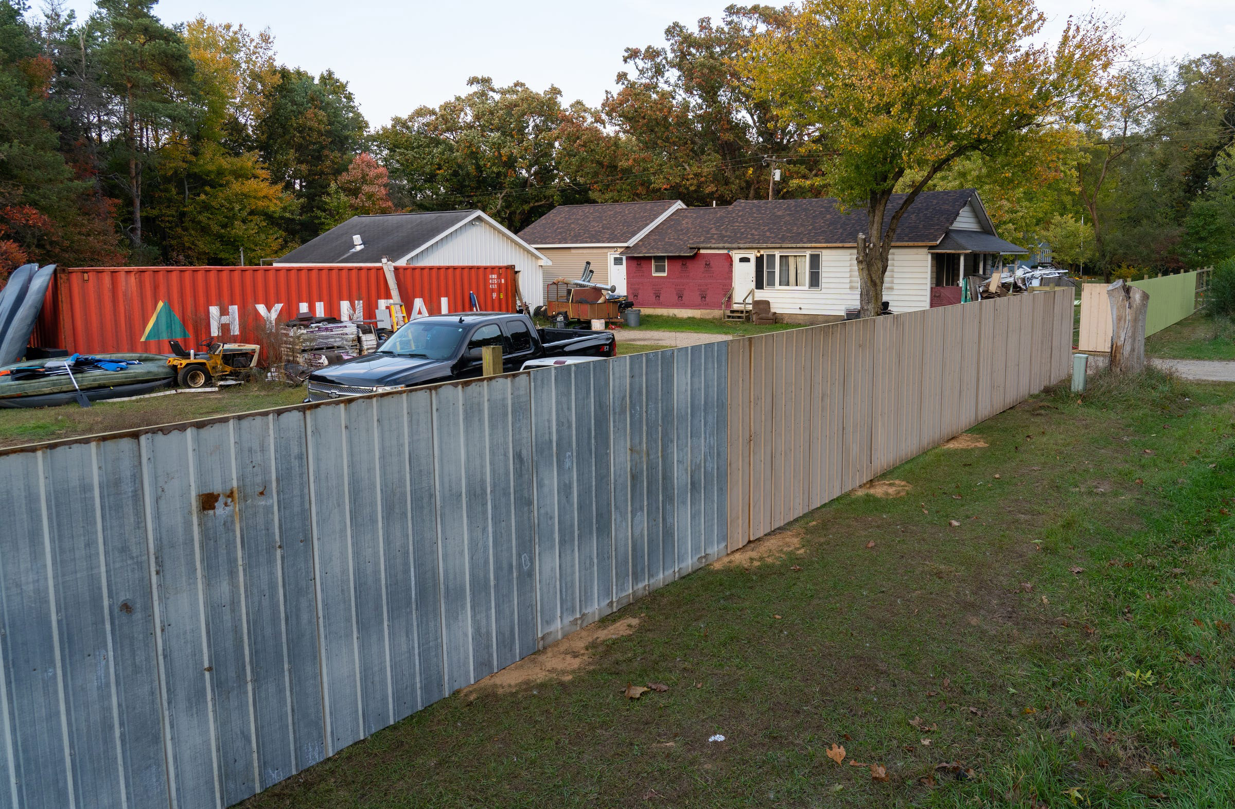 A wall recently constructed outside of the home of William Null in Shelbyville, Mich., Oct. 9, 2020. Null is one of 13 suspects accused of plotting to abduct Michigan Gov. Gretchen Whitmer.