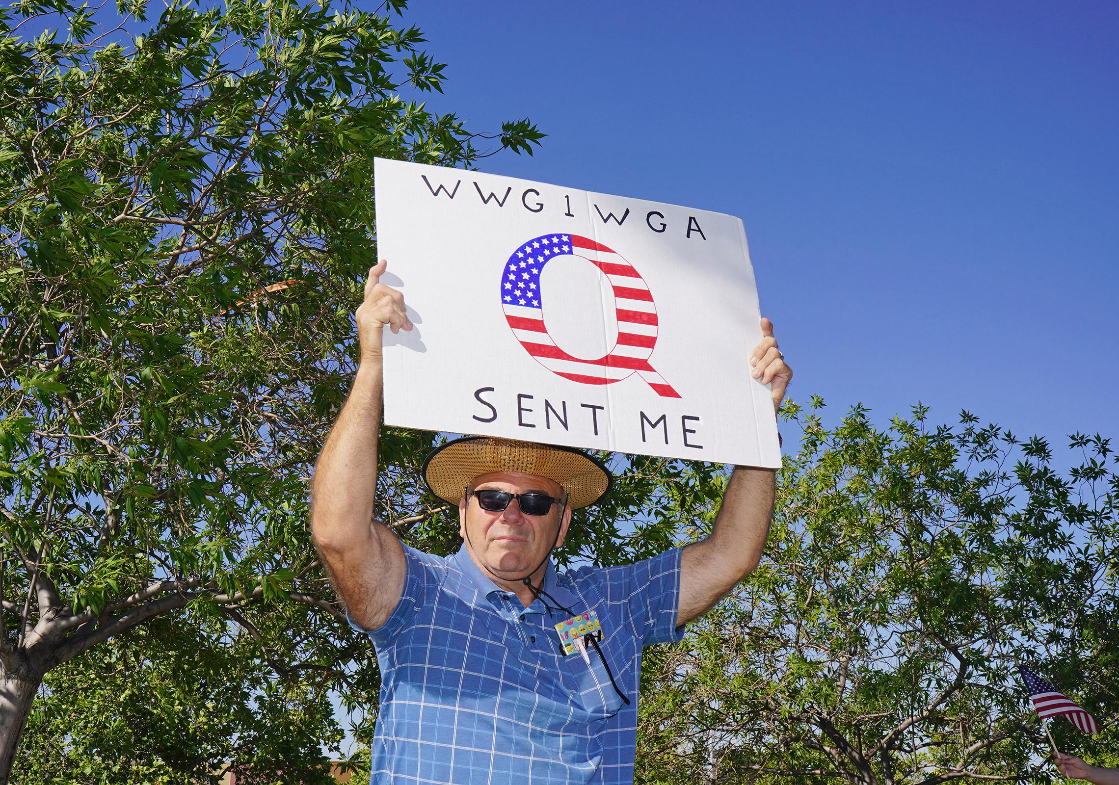 A protester with a QAnon sign at an anti-lockdown rally in Santa Clarita, Calif., May 21, 2020.