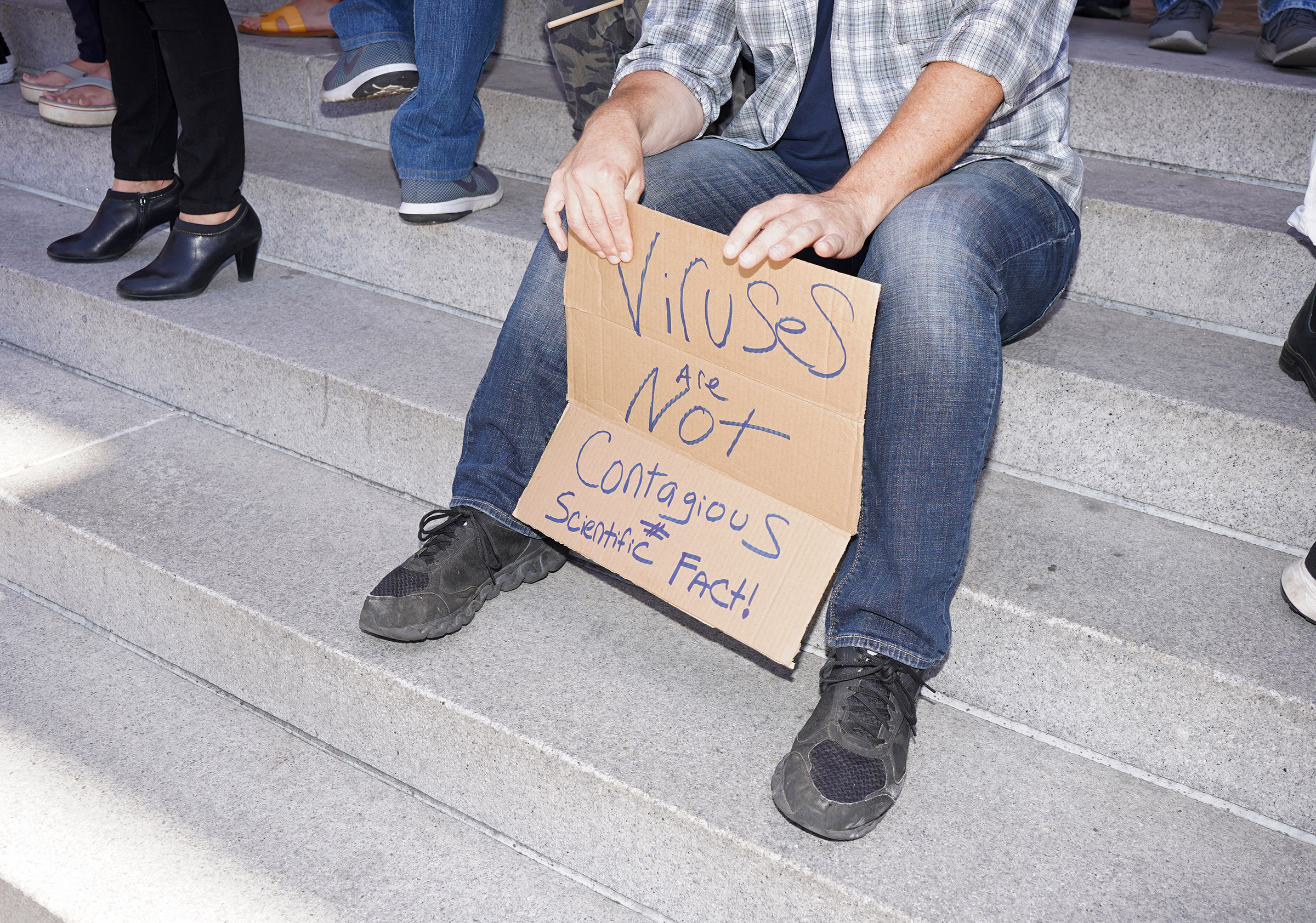 A protestor's sign at a rally calling for the reopening of California from coronavirus lockdown measures in Los Angeles, May 24, 2020.