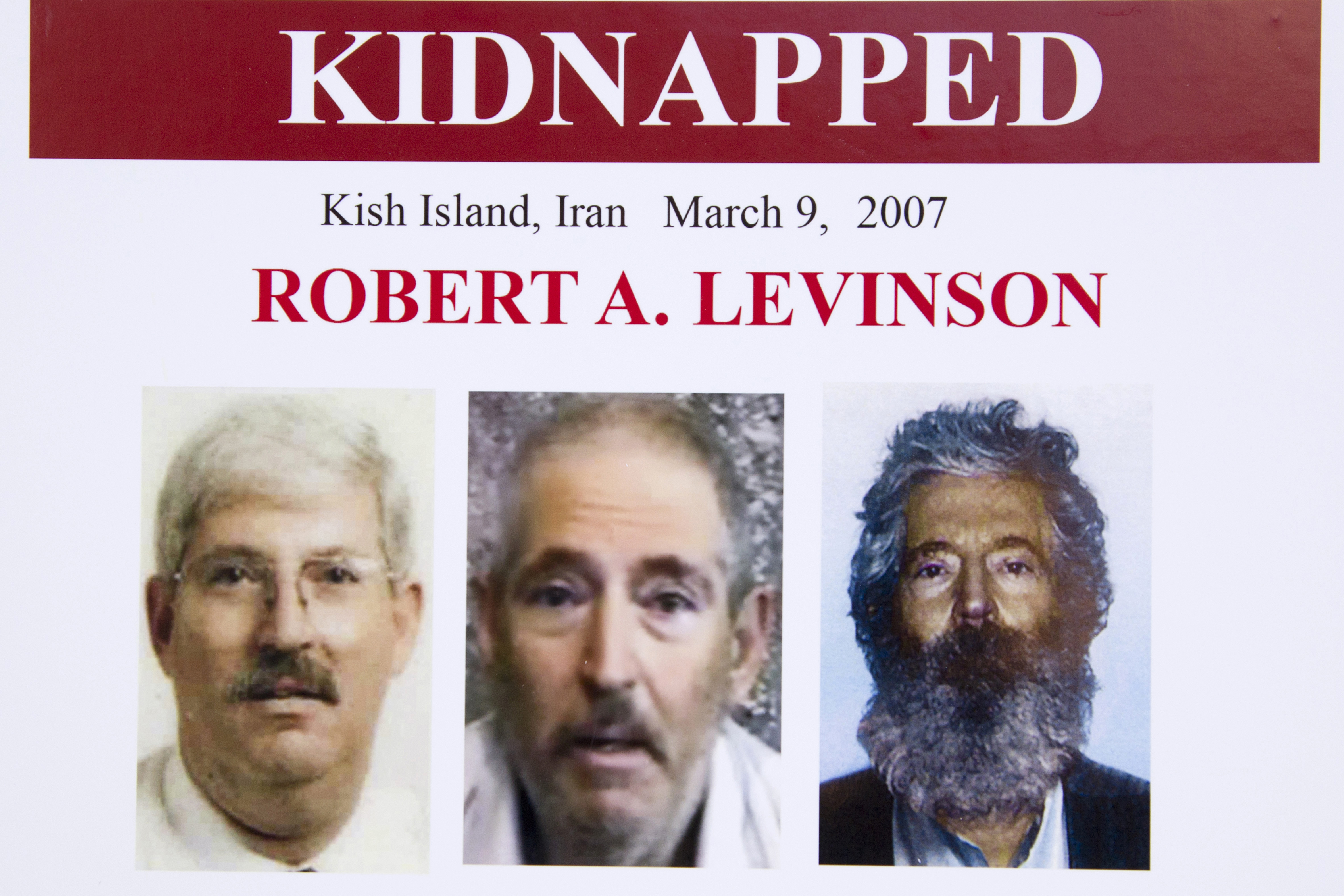 In this March 6, 2012, file photo, an FBI poster showing a composite image of former FBI agent Robert Levinson, right, of how he would look like now after five years in captivity, and an image, center, taken from the video, released by his kidnappers, and a picture before he was kidnapped, left, displayed during a news conference in Washington. A federal judge has held Iran responsible for the kidnapping of former FBI agent Robert Levinson. U.S. District Judge Timothy Kelly entered a default judgement against the regime on the 13th anniversary on his disappearance.