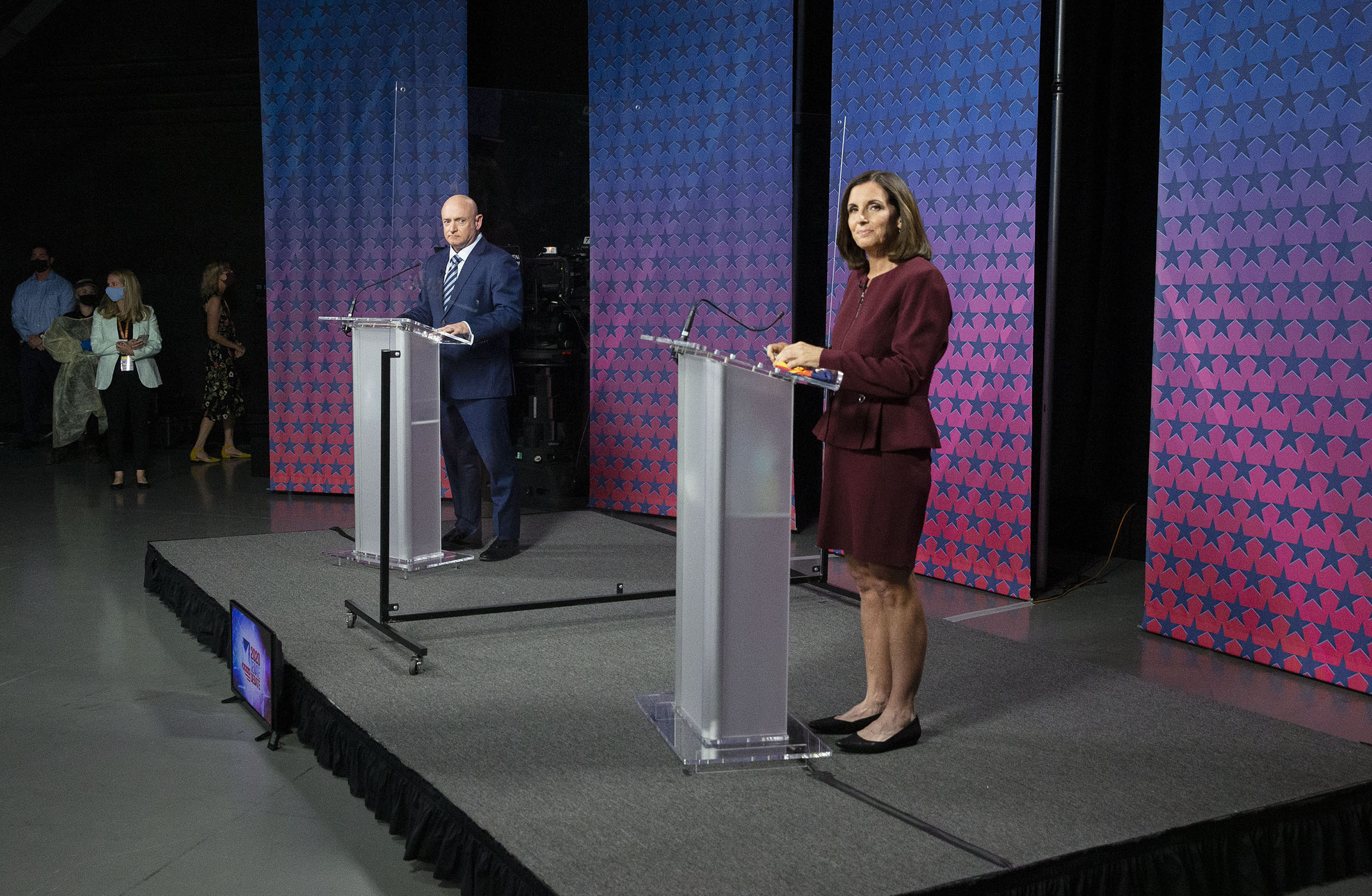 Democratic challenger Mark Kelly and U.S. Sen. Martha McSally, R-Ariz. are separated by plexiglass as they participate in a debate at Arizona State University in Phoenix, AZ on Oct. 6, 2020.