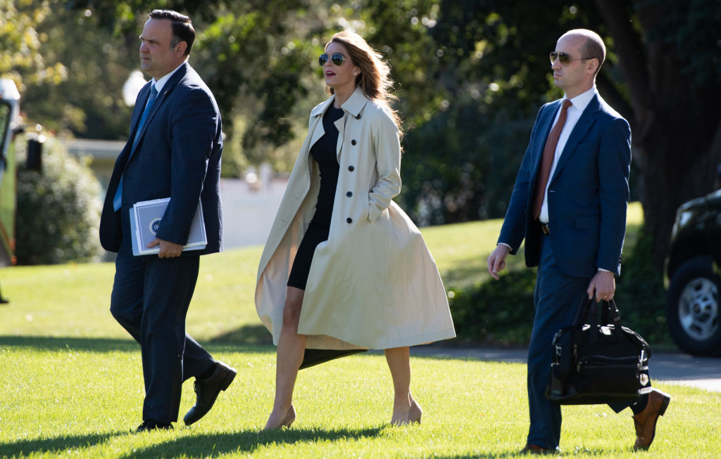 Dan Scavino (left), the director of White House social media, Hope Hicks, White House counselor, and Stephen Miller (right), White House senior adviser, walk to Marine One prior to departing with President Donald Trump from the South Lawn of the White House in Washington, DC, Sept. 21, 2020, as he travels to Ohio. Both Hicks and Miller have tested positive for COVID-19.