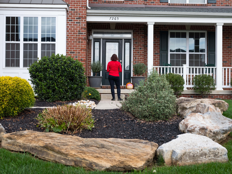 Republican nominee, Lisa Scheller, goes door to door while canvasing in Allentown, Pa., on Oct. 24, 2020.