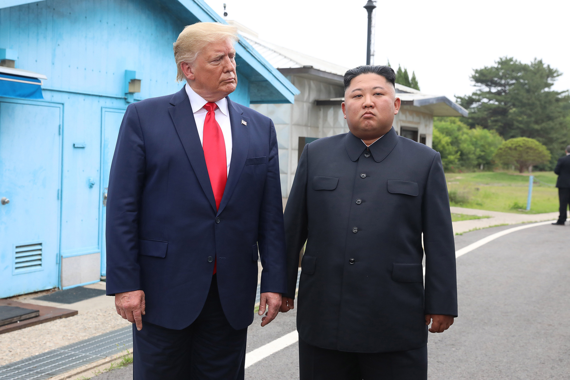 North Korean leader Kim Jong Un and U.S. President Donald Trump meet inside the demilitarized zone separating South and North Korea in Panmunjom, South Korea, June 30, 2019.