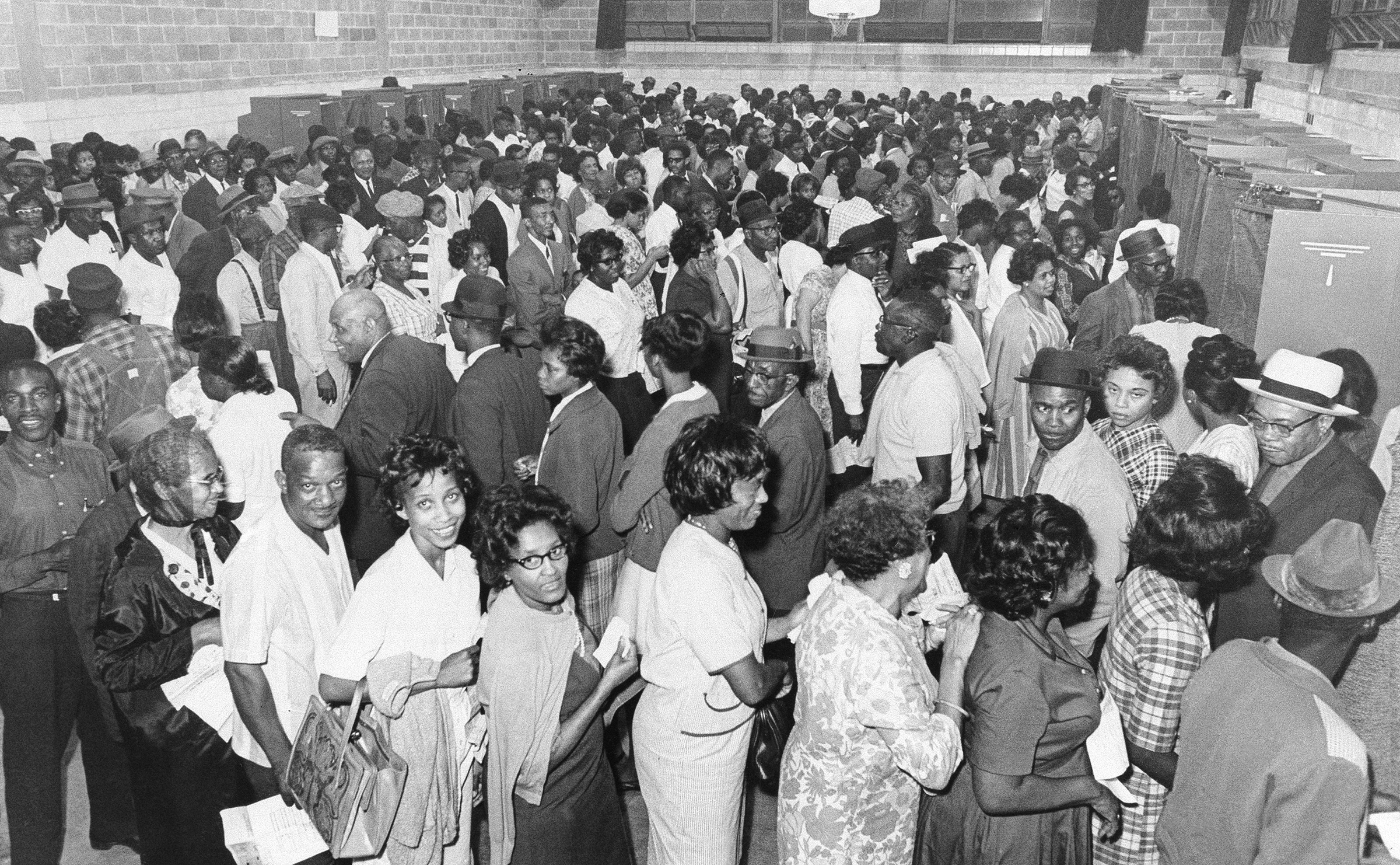 African Americans line up to vote after the passage of the Voting Rights Act in 1965
