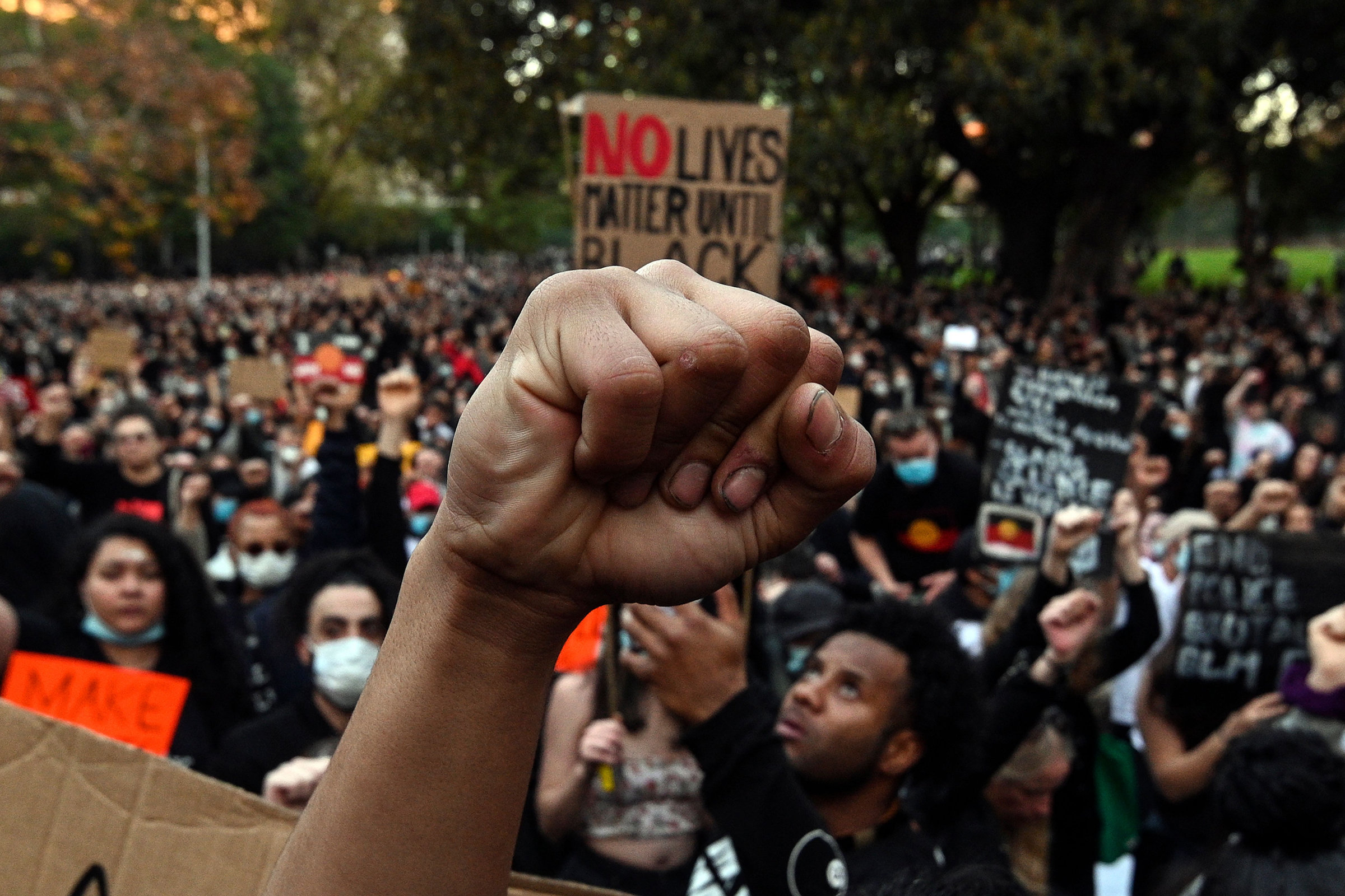 Demonstrators attend a Black Lives Matter protest to express solidarity with US protestors and demand an end to Aboriginal deaths in custody in Sydney, Australia,on June 6, 2020.