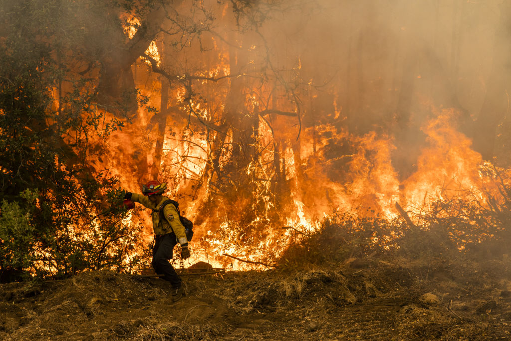 A firefighter ignites a controlled burn during the Glass Fire near Calistoga, California, U.S., on Friday, Oct. 2, 2020.