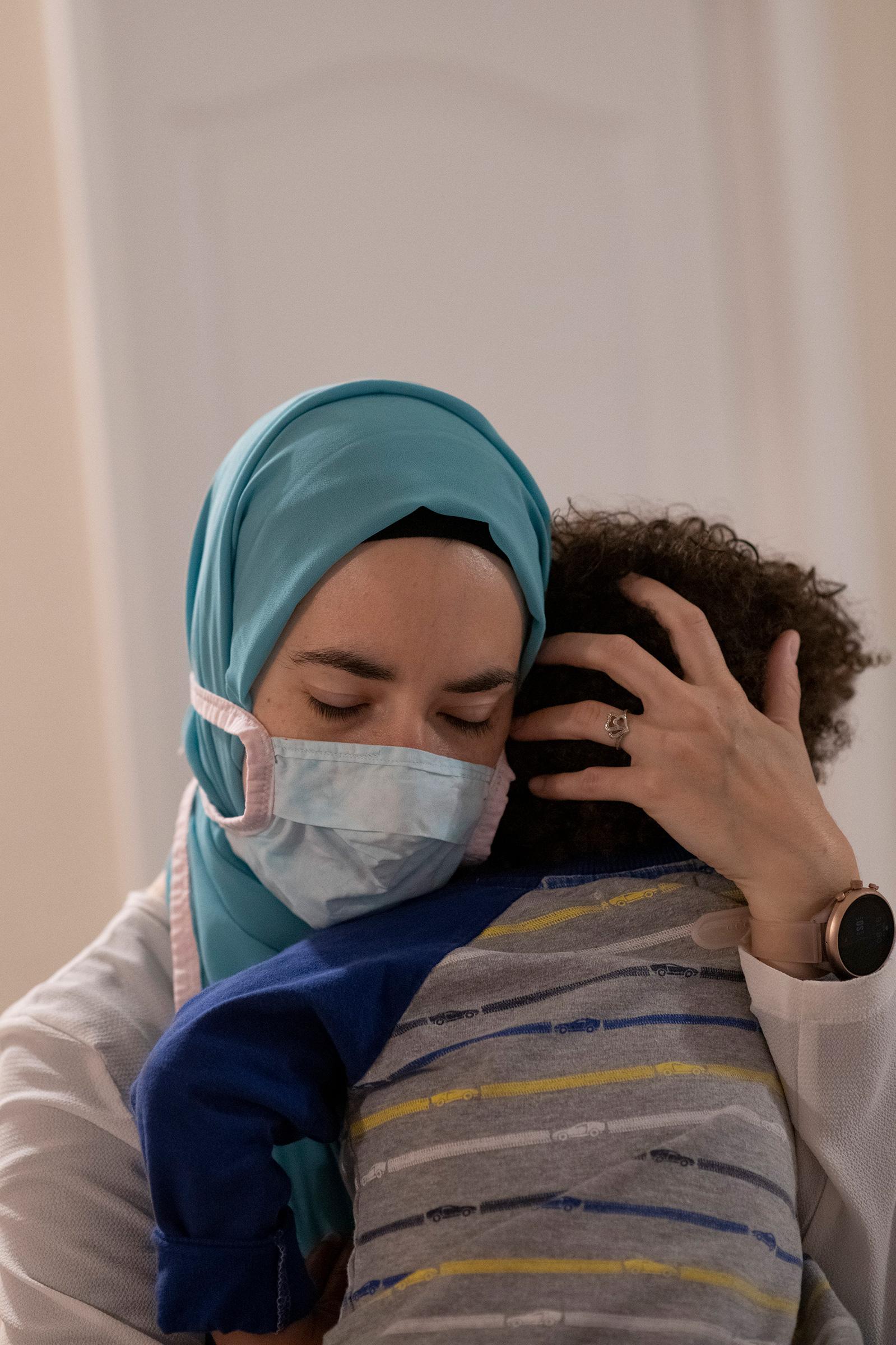 Brittany Schultz comforts her son, Gabriel, on Sept. 17