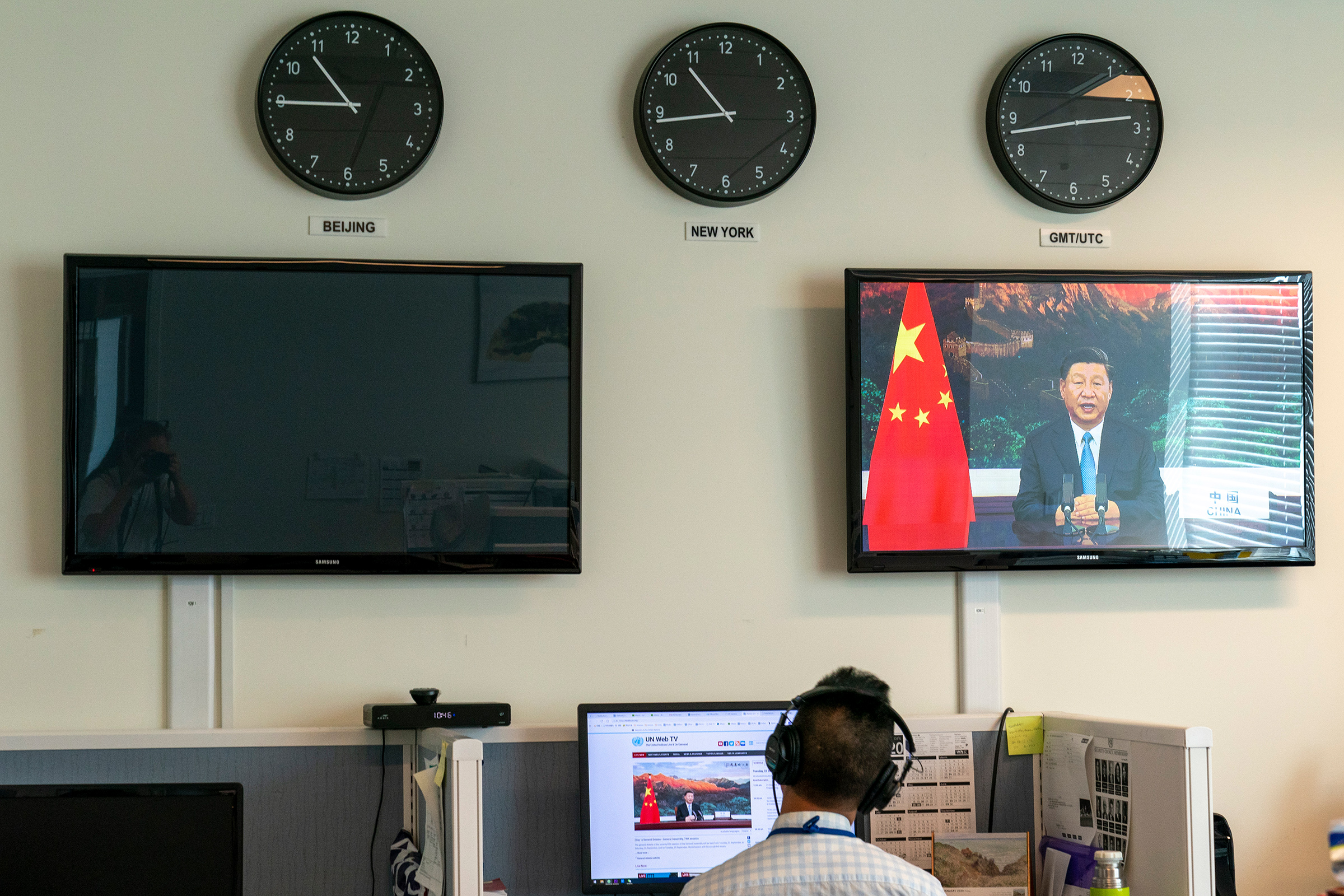 A Xinhua reporter watches as Xi remotely addresses the U.N. General Assembly on Sept.22
