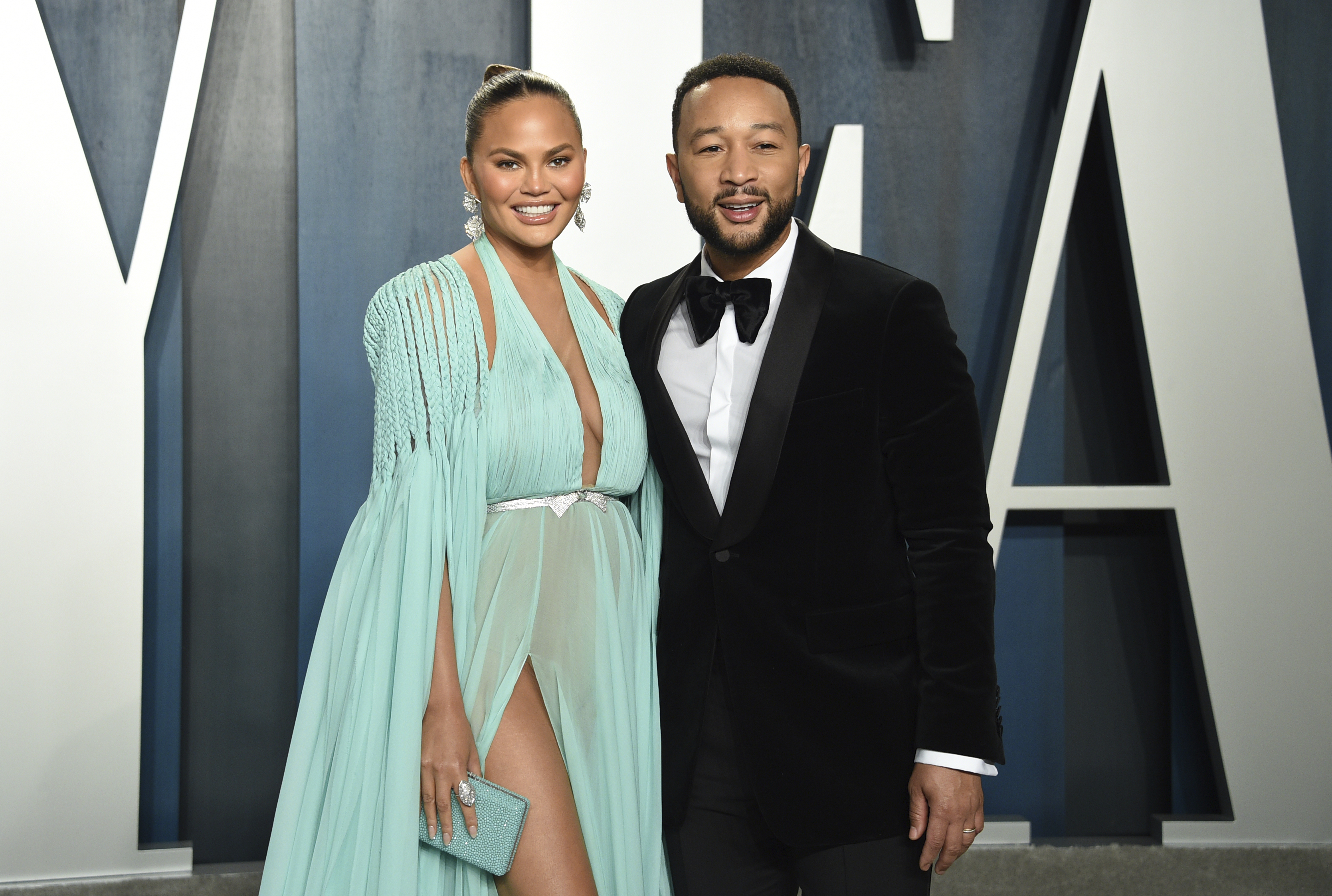 In this Feb. 9, 2020 file photo, Chrissy Teigen, left, and John Legend arrive at the Vanity Fair Oscar Party in Beverly Hills, Calif.