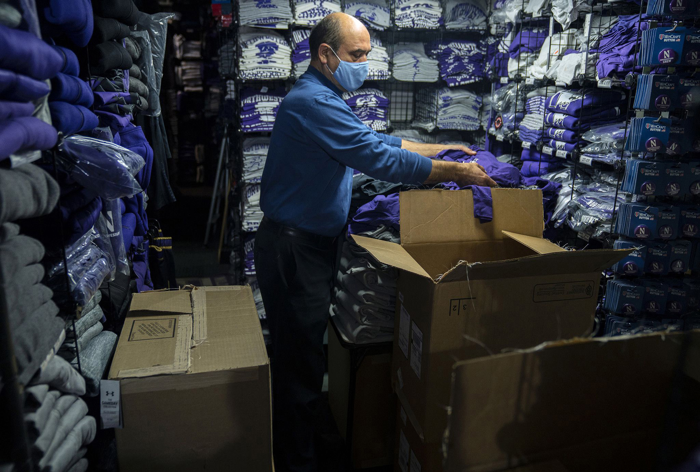 David Haghnaji, owner of Campus Gear in downtown Evanston, Ill., stocks another of his locations—The Locker Room, across from Ryan Field—with new Northwestern gear on Oct. 15, 2020.