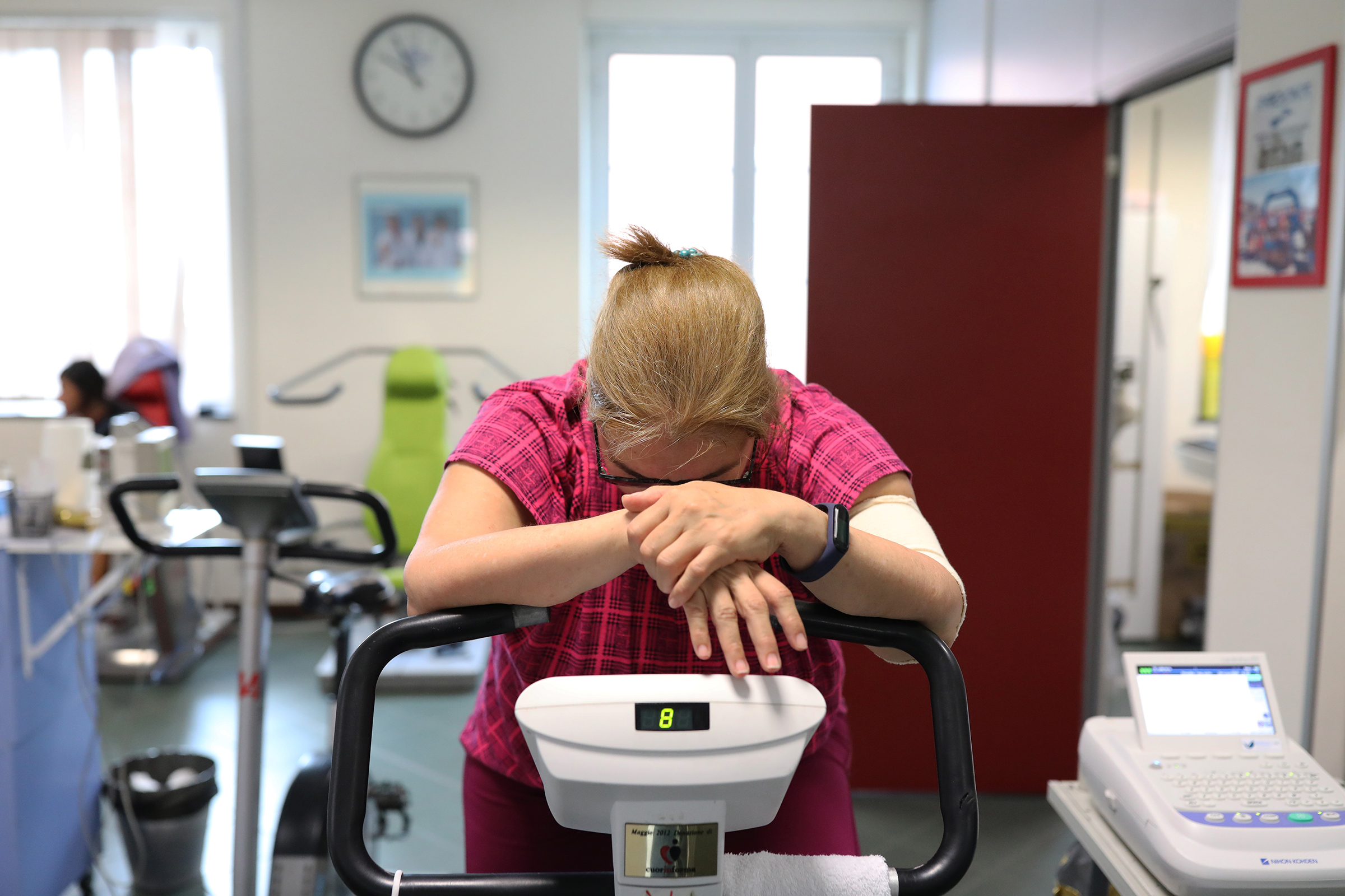 A former COVID-19 patient rides on an exercise bike to strengthen muscle tone at the Department of Rehabilitative Cardiology of ASL 3 Genova on July 24 in Genoa, Italy. She was in the hospital for 15 days, suffering from great fatigue.