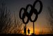 The Olympic rings are seen as sunset in the Olympic Park in Stratford