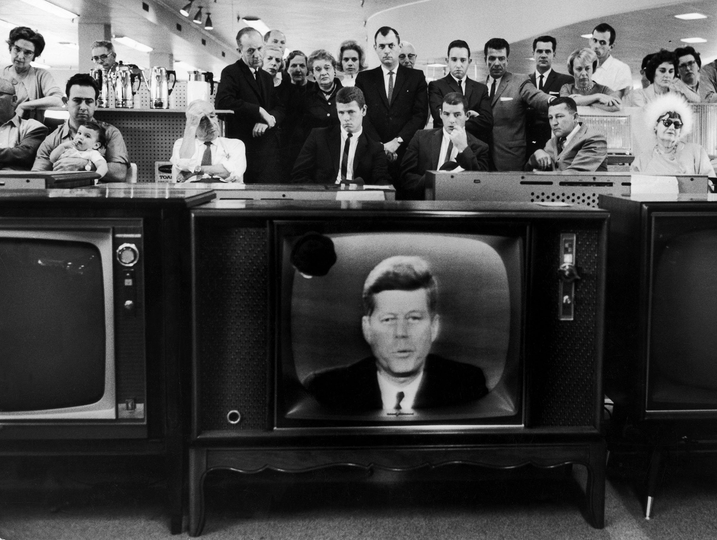 People watching President John F. Kennedy's TV announcement of Cuban blockade during the missile crisis in a department store in California on Oct.22, 1962.
