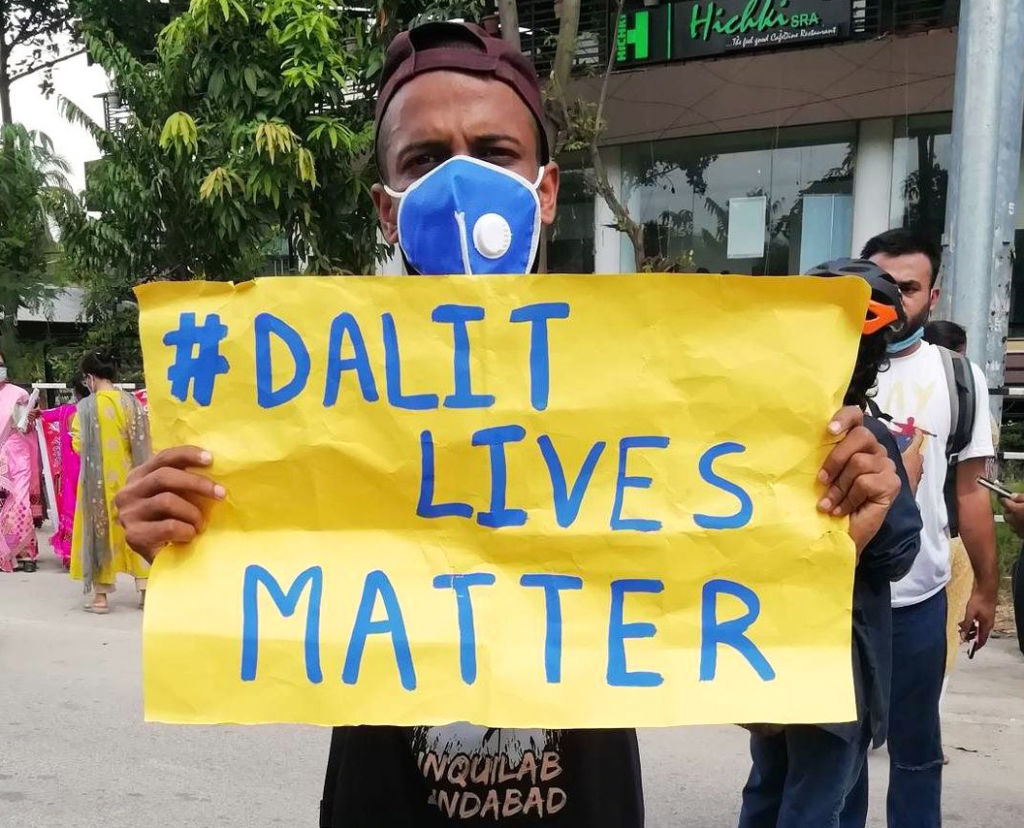 A protester holds a sign reading  Dalit Lives Matter  at a protest against the Hathras gang rape, in Guwahati, Assam, India on October 3, 2020.