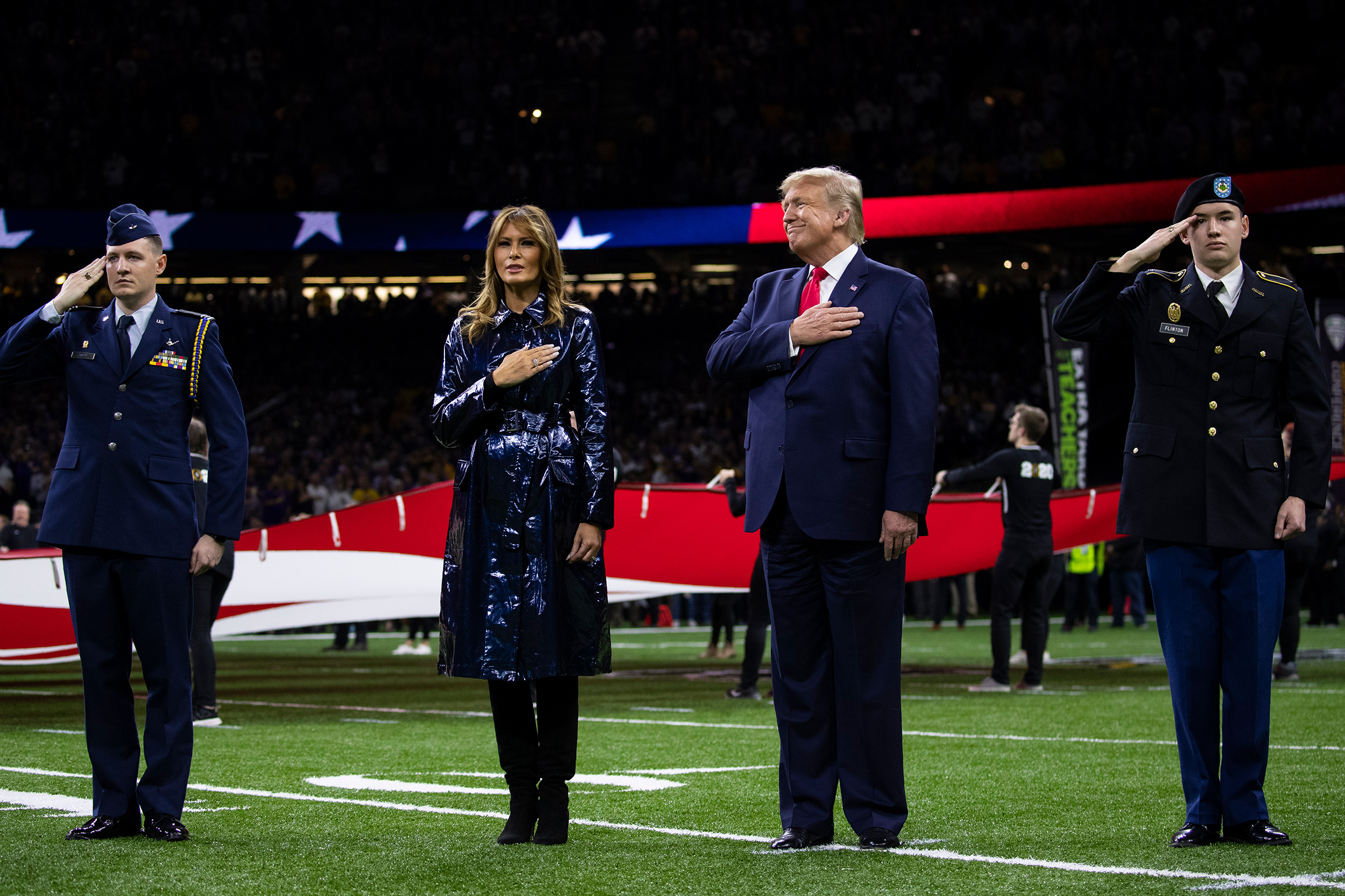 President Donald Trump and first lady Melania Trump stand for the national anthem before the beginning of the College Football Playoff National Championship game on Jan. 13 in New Orleans