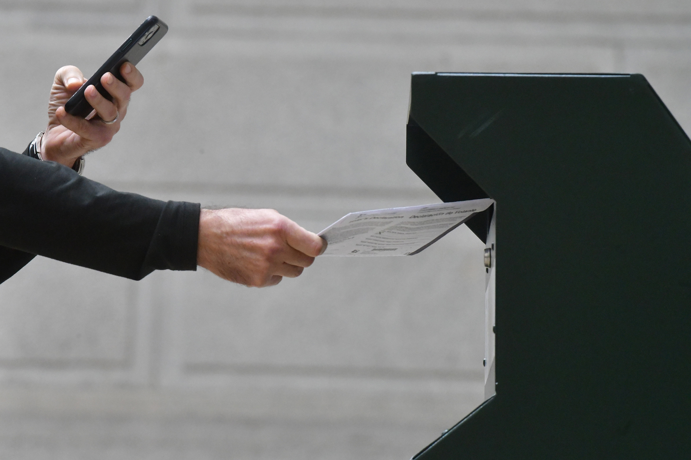A man  photographs himself depositing his ballot in an official ballot drop box outside of Philadelphia City Hall on Oct. 27. Misinformation about voting has been spreading online