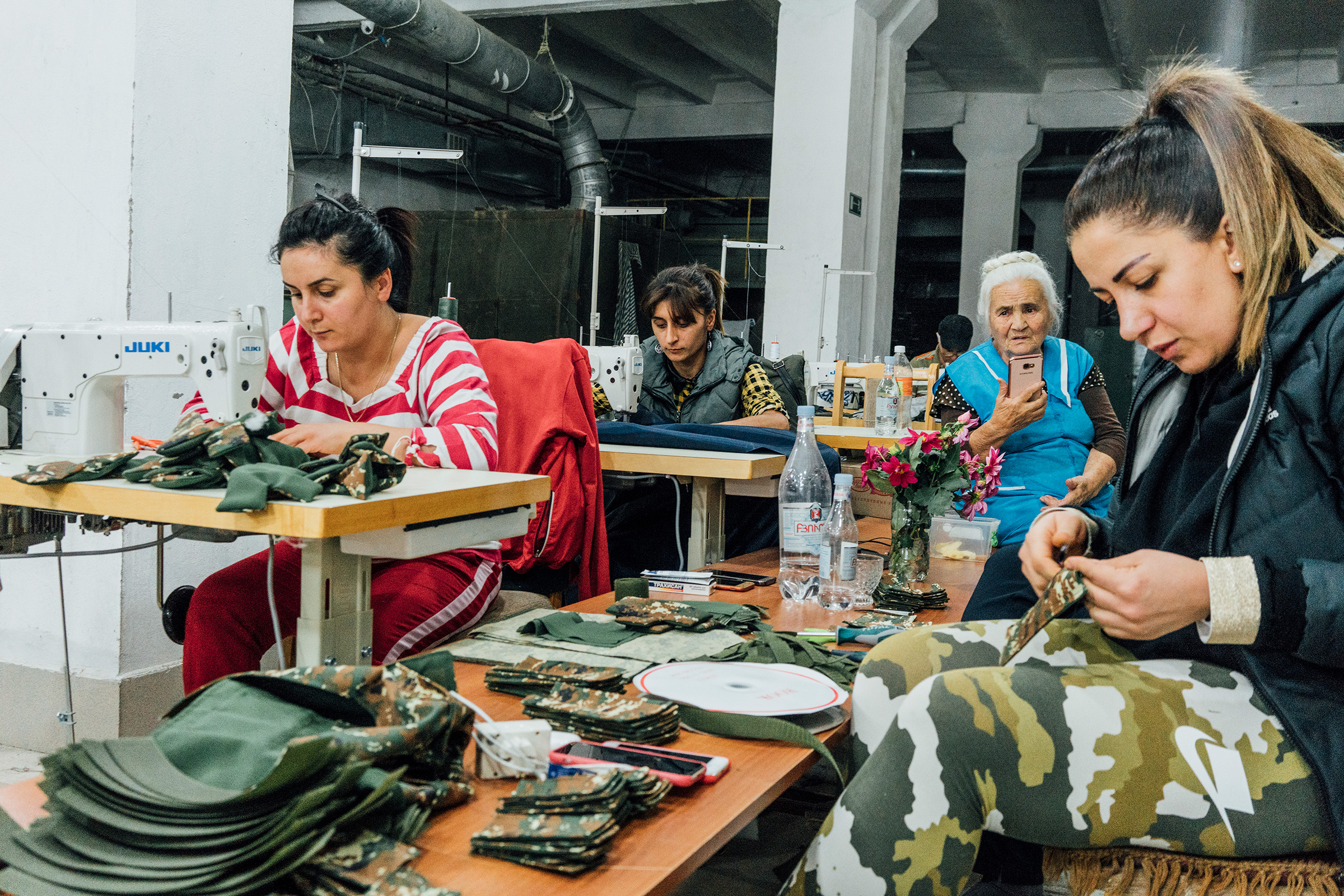 Armenian volunteers in Stepanakert sew uniforms and sleeping bags for soldiers on the frontline.