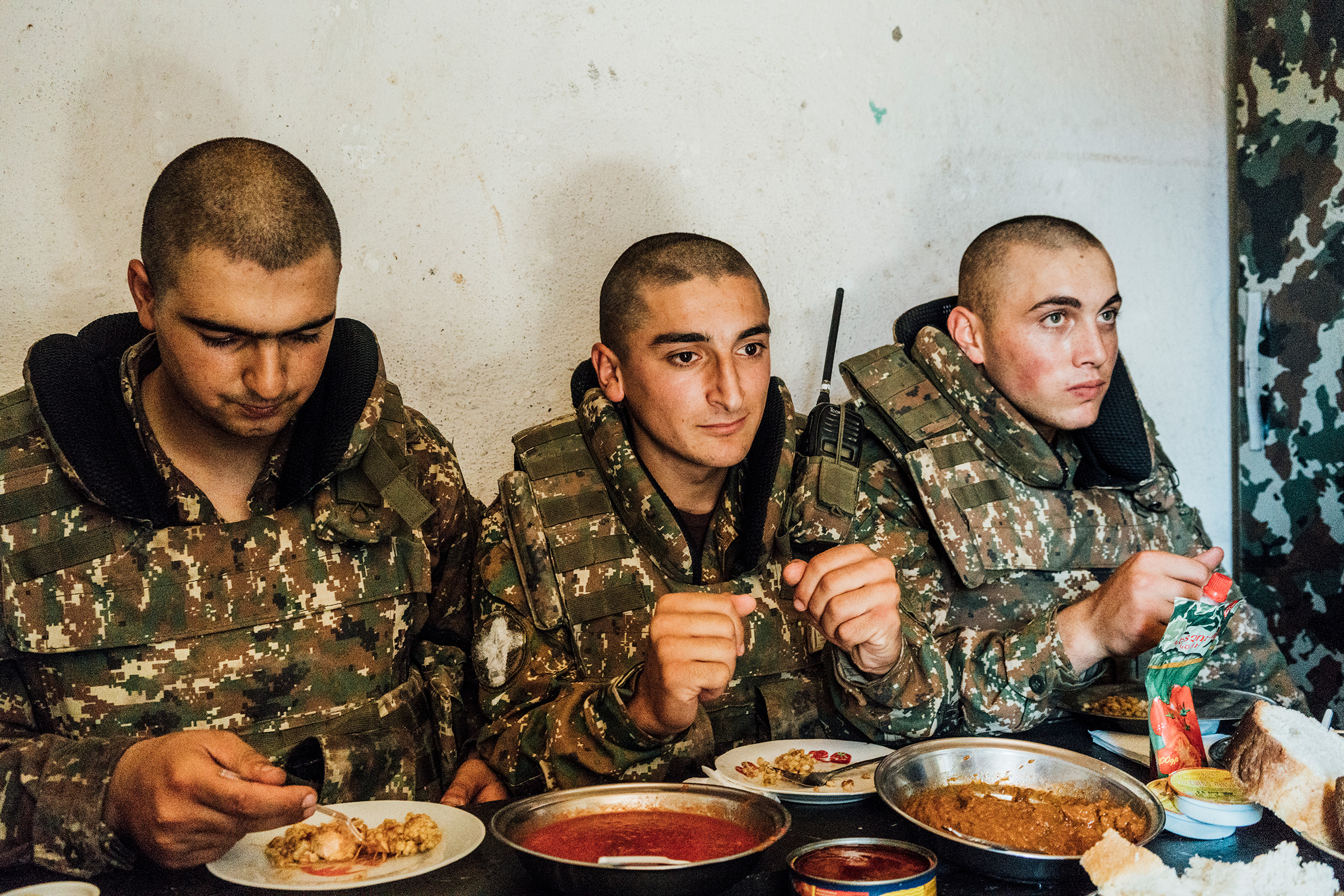Armenian soldiers eat their rations inside a bunker on a frontline position near the town of Askeran.
