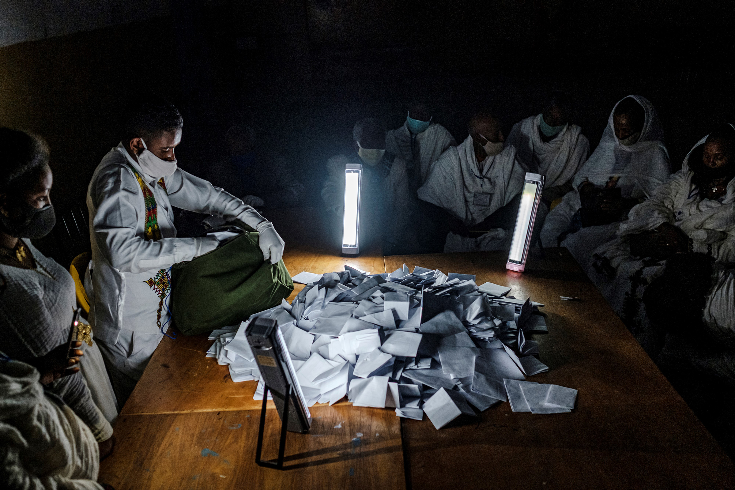 Electoral officials open a ballot box at a polling station on the day of Tigray's regional elections, on Sept. 9, 2020 in Mekele