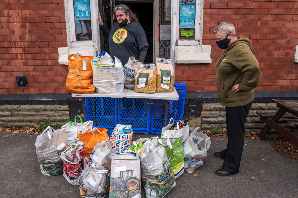 A food bank accepts a donation on October 20, 2020 in Ashton under Lyne, England.