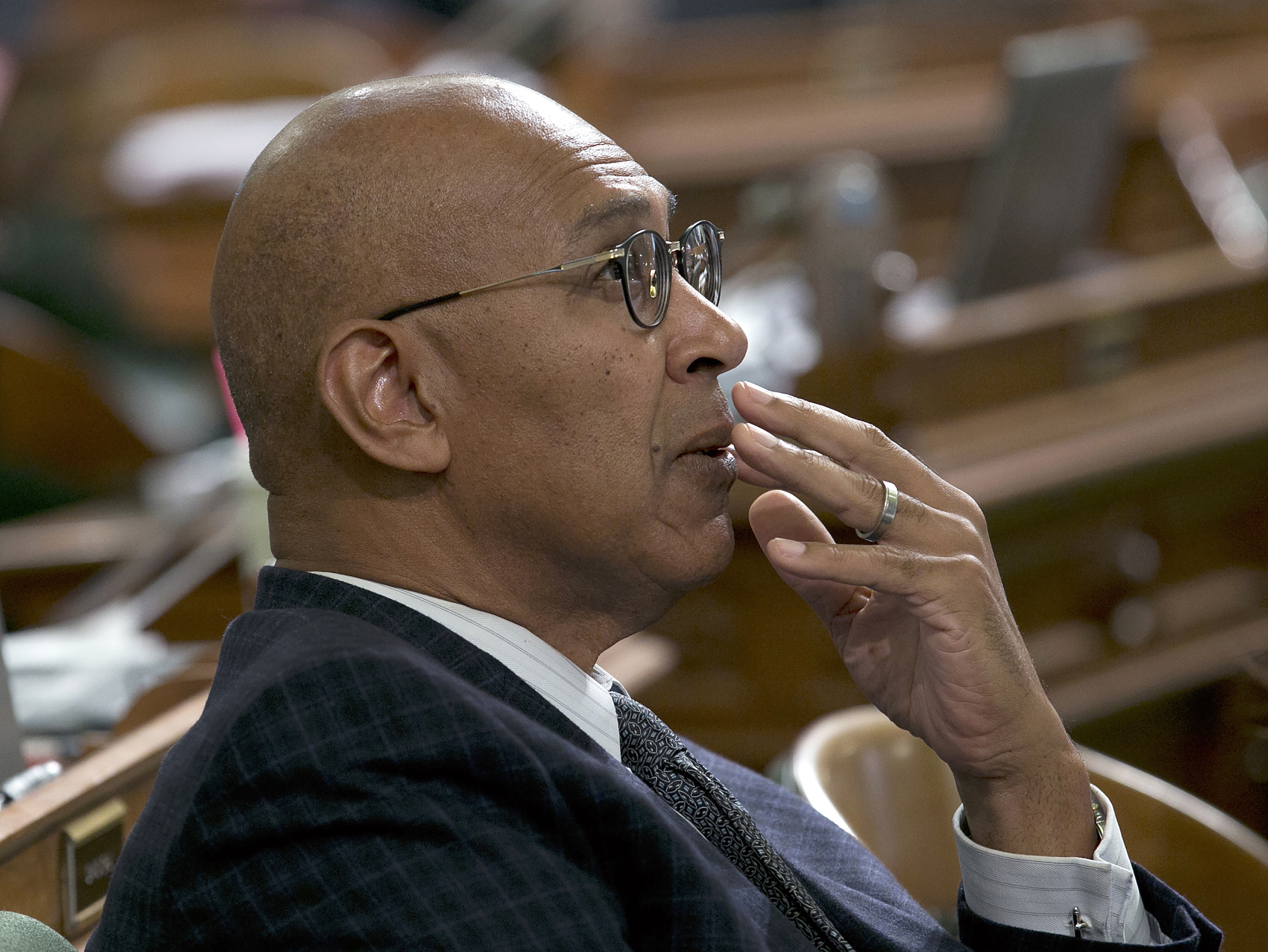 In this Sept. 13, 2017, file photo, Assemblyman Chris Holden, D-Pasadena, watches as the votes are posted for a measure at the Assembly in Sacramento, Calif. Hundreds of California-based corporations must have directors from racial or sexual minorities on their boards under a first-in-the-nation bill signed Wednesday, Sept. 30, 2020, by Gov. Gavin Newsom, that Holden authored.