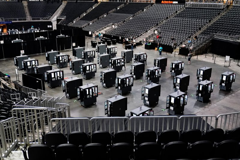 Voting machines fill the floor for early voting at the State Farm Arena on Monday, Oct. 12, 2020, in Atlanta.