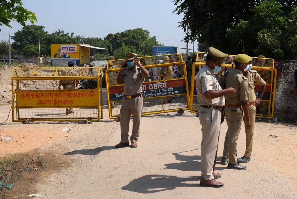 Police barricading on the way to the home of the victim in the Hathras gang rape case on October 1, 2020 in Hathras, India.