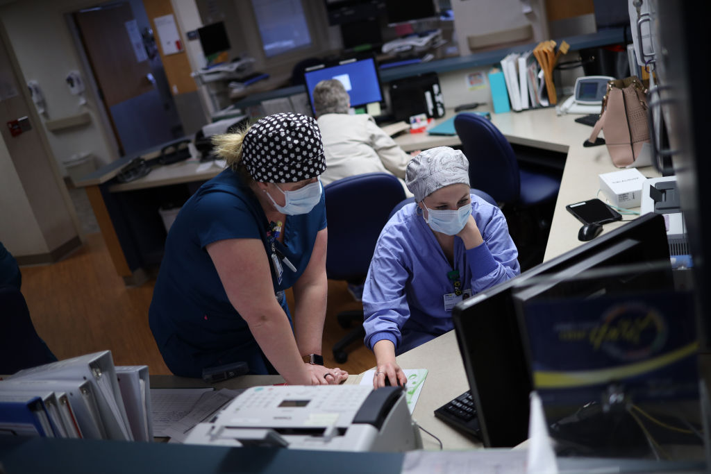 Nurses work on a computer while treating patients with coronavirus in the intensive care unit at a hospital on May 1, 2020 in Leonardtown, Maryland.