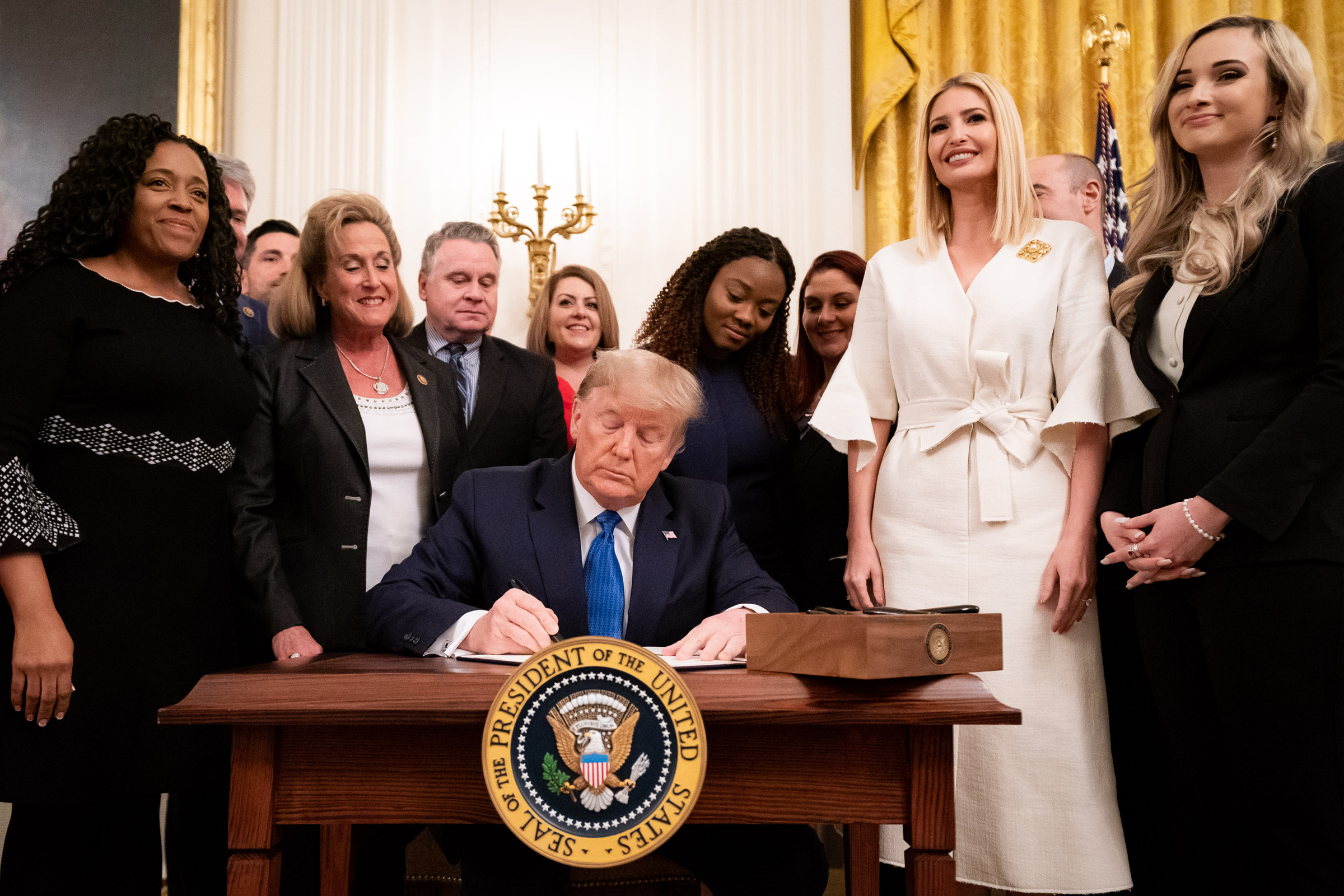 President Donald J. Trump signs an Executive Order for Combating Human Trafficking and Online Child Exploitation in the United States, at the White House Summit on Human Trafficking on Jan. 31, 2020.