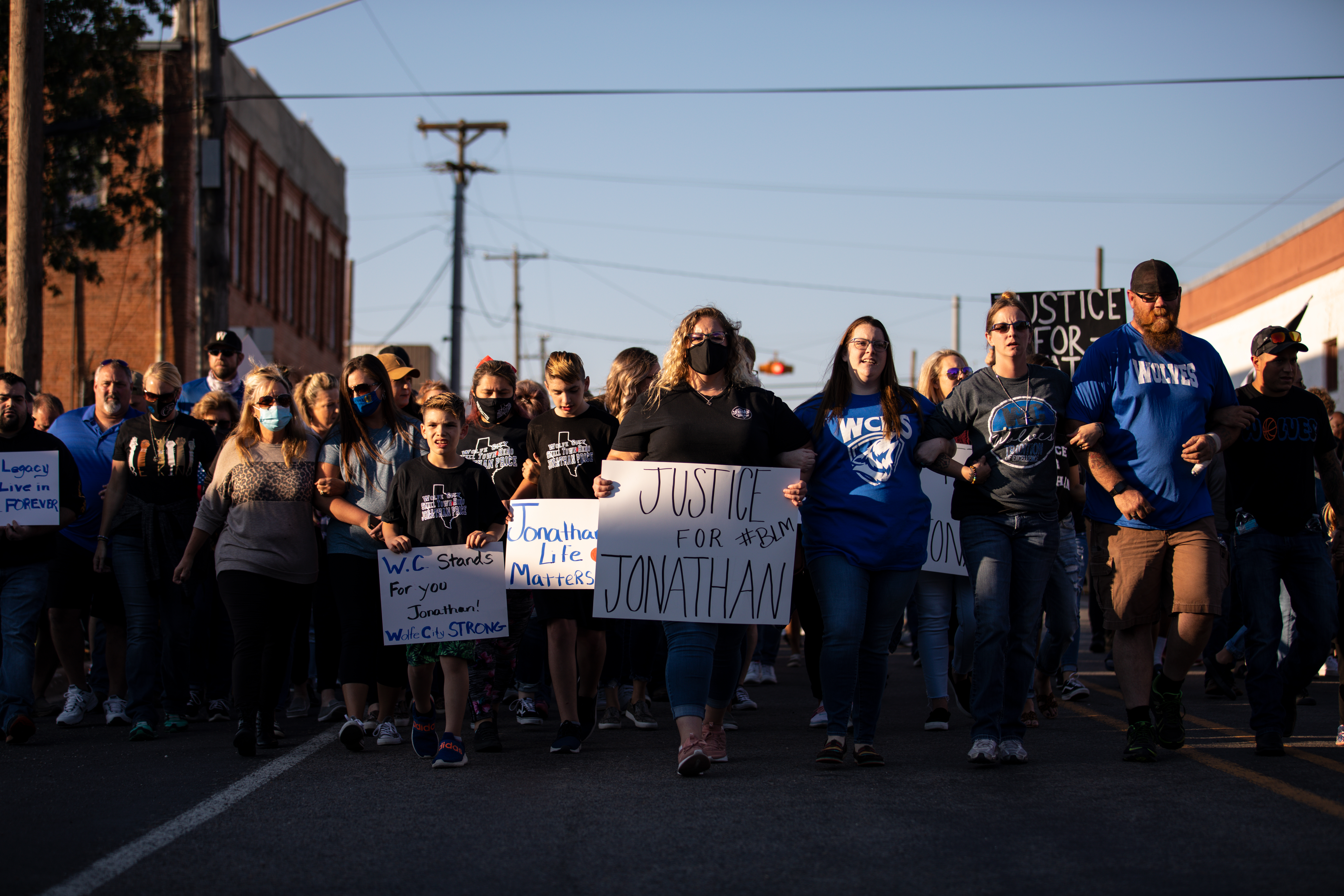 People gather for a march, rally and candle light vigil in honor Jonathan Price on Oct. 5, 2020 in Wolfe City, Texas.