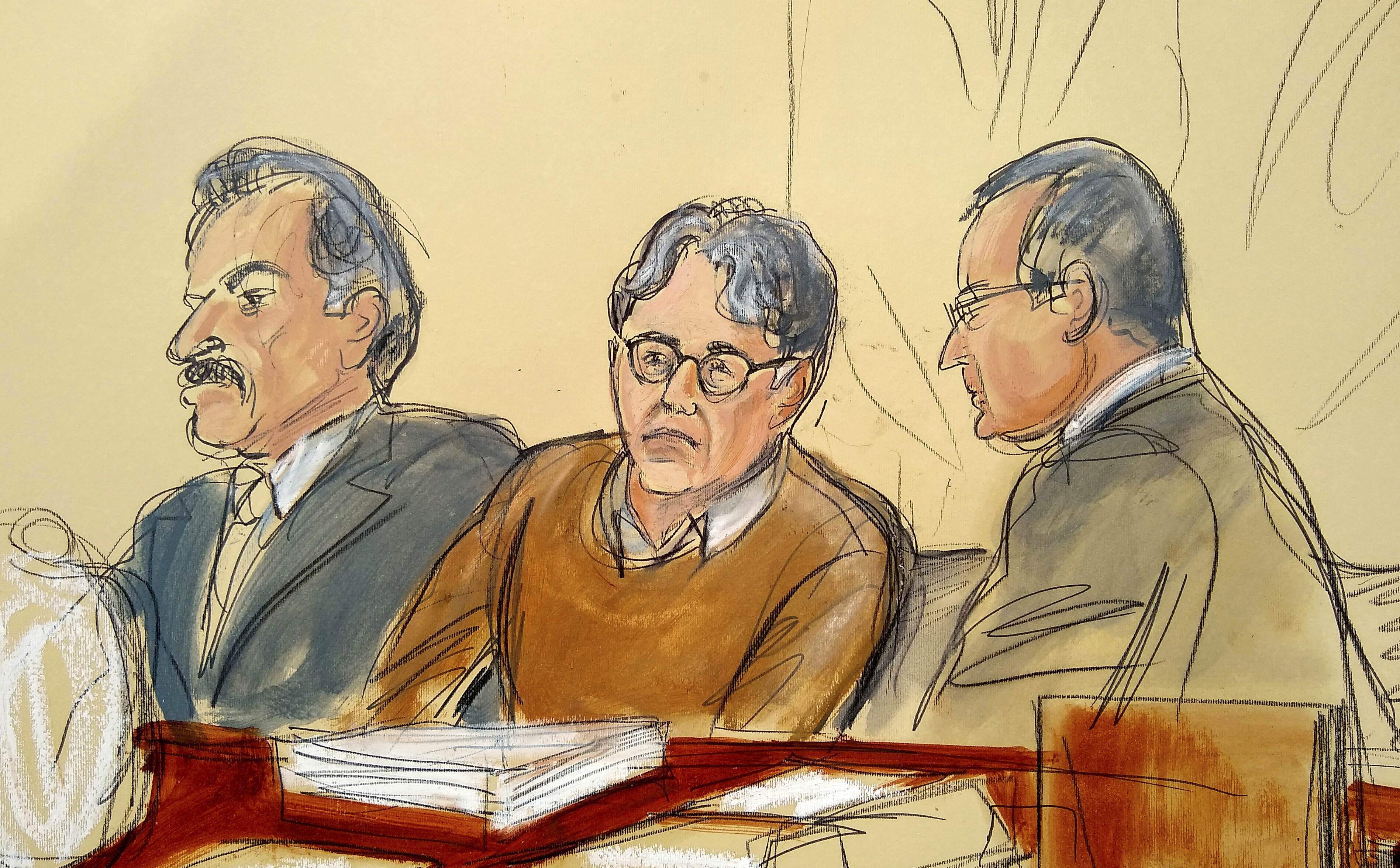 In this Tuesday, May 7, 2019, file courtroom drawing, defendant Keith Raniere, center, leader of the secretive group NXIVM, is seated between his attorneys Paul DerOhannesian, left, and Marc Agnifilo during the first day of his sex trafficking trial.