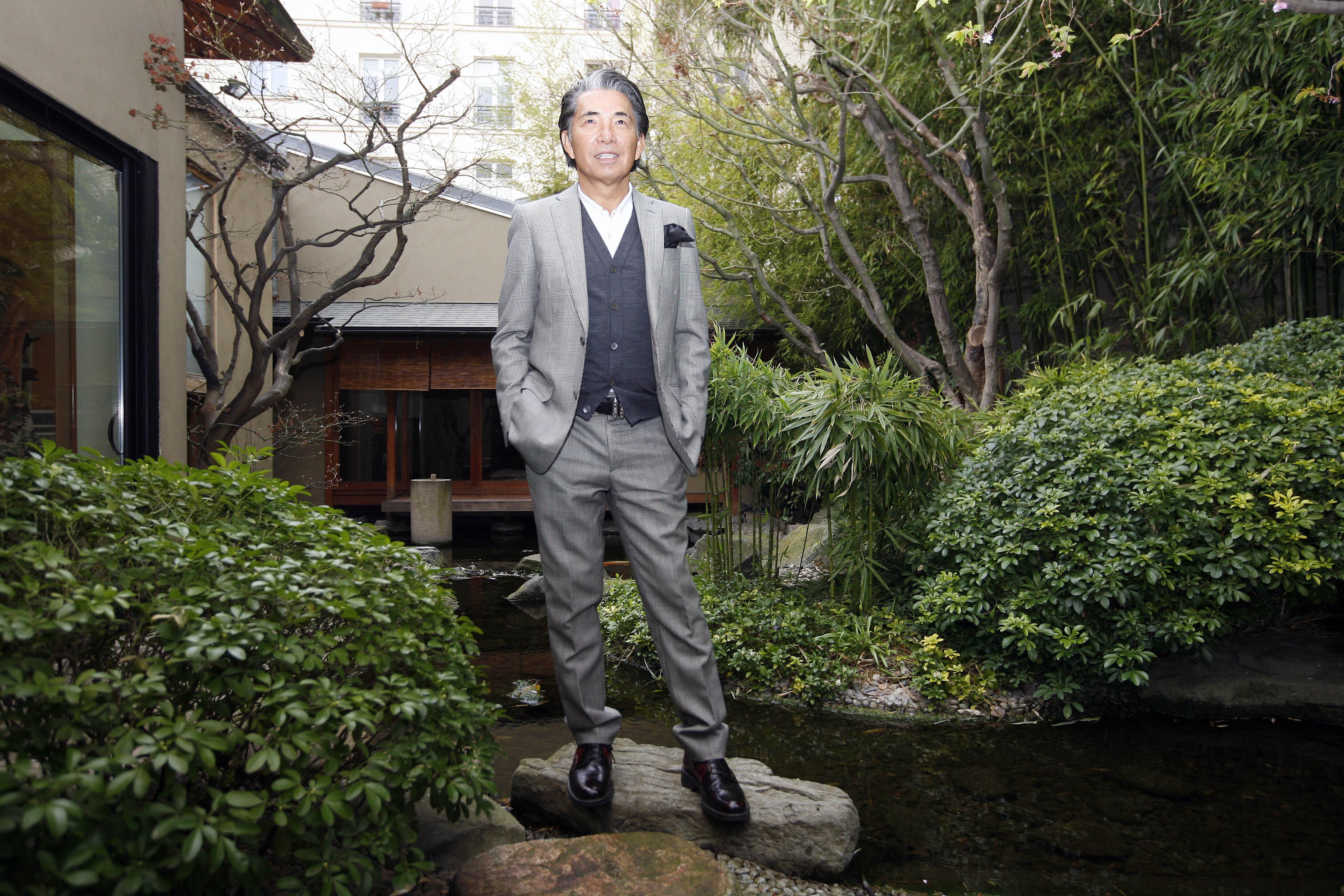 Japanese fashion designer Kenzo Takada poses outside his Paris house, on March 24, 2009.