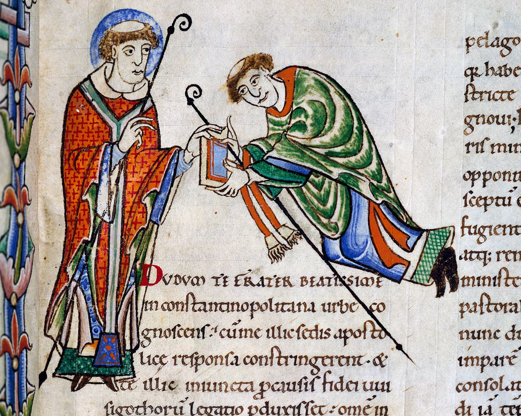 St. Gregory offering his book to Bishop Leandro, miniature from Commentary on the Book of Job, from the Abbey of Citeaux. France, 12th century.