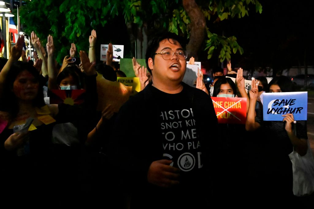 sings during a Milk Tea Alliance protest outside the Chinese embassy in Bangkok on Oct. 1, 2020.