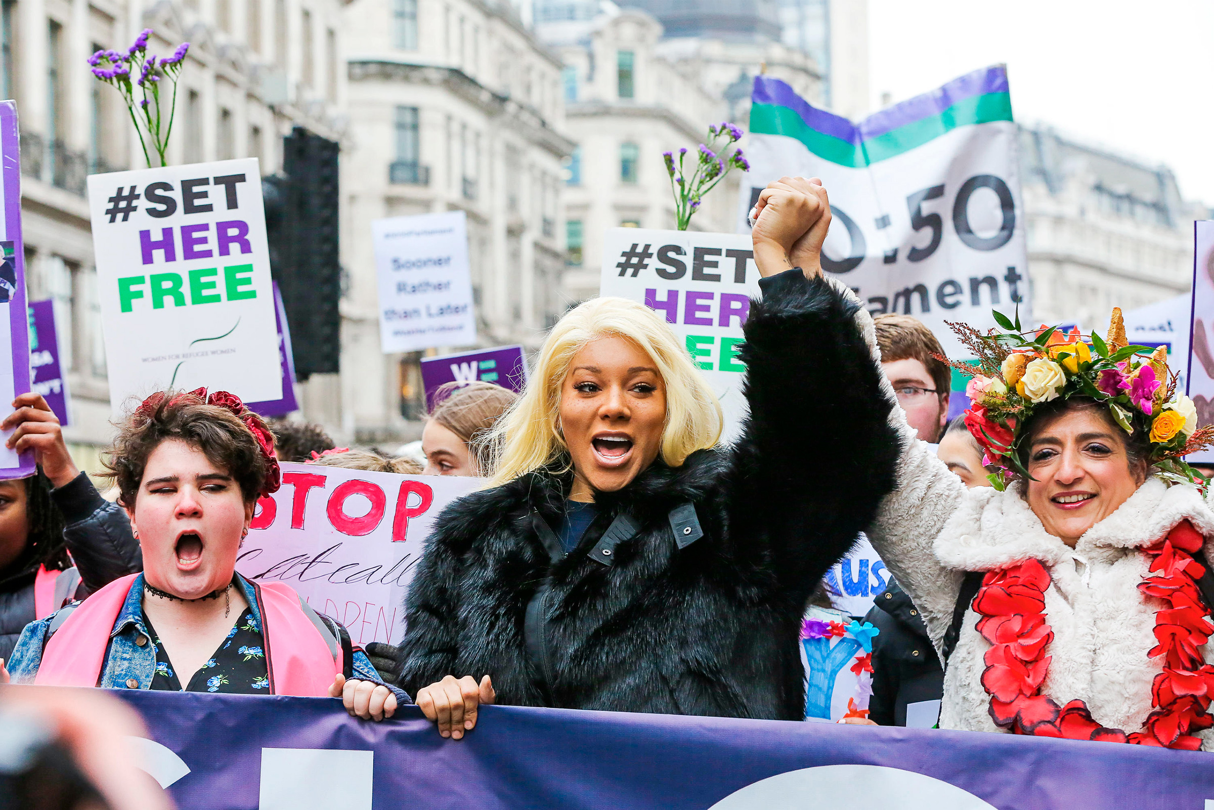 Bergdorf joins thousands of women taking part in the Global Women's March in London in January 2019.