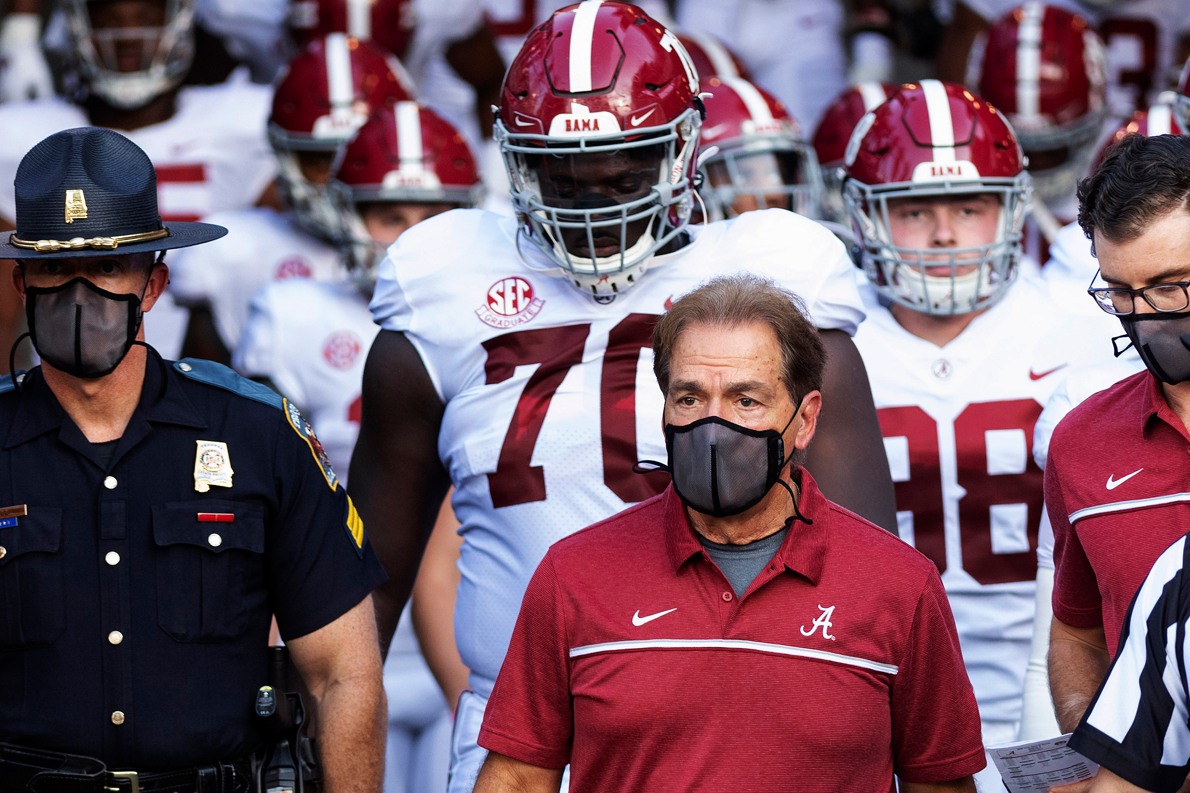 Alabama coach Nick Saban leads his team to the field before an NCAA college football game against Missouri in Columbia, Mo., on Sept. 26, 2020. Saban and athletic director Greg Byrne tested positive for COVID-19, days before the Southeastern Conference's biggest regular-season showdown.