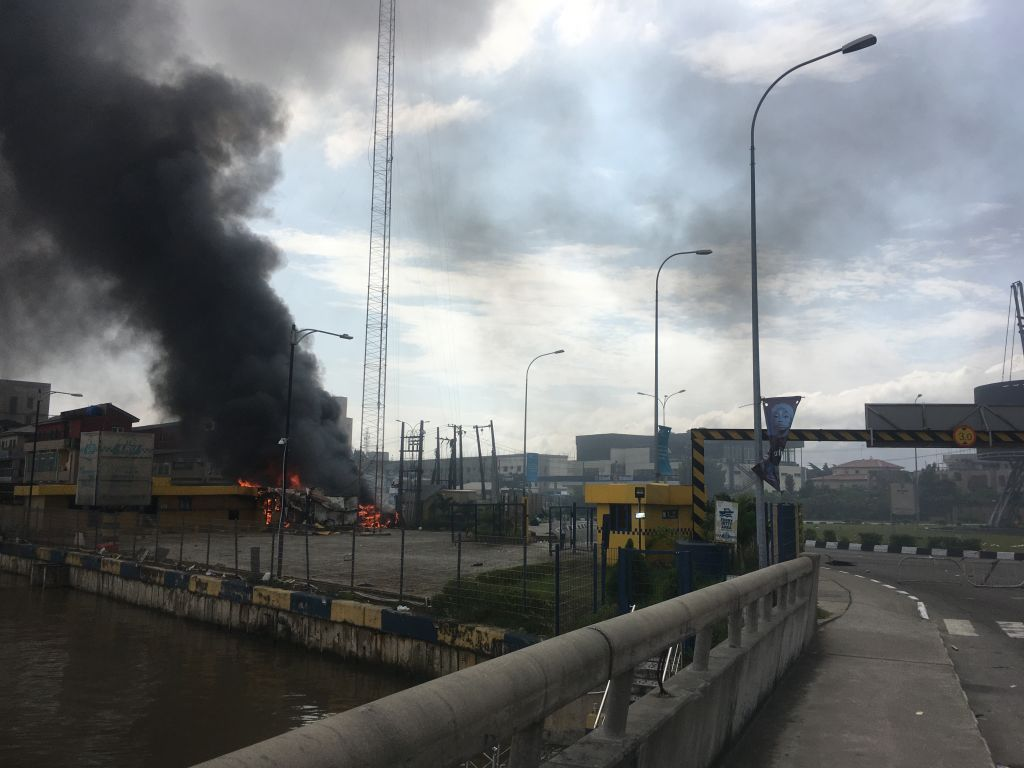A general view of a building on fire near the Lekki-Ikoyi Toll Gate in Lagos on Oct. 21, 2020, after a deadly shooting of peaceful protesters in Lagos that Amnesty International blamed on security forces.