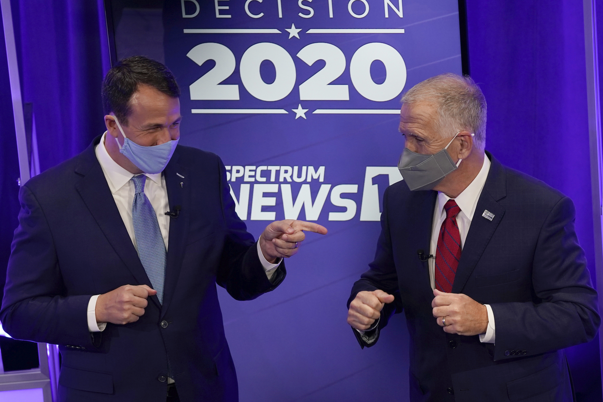 Democratic challenger Cal Cunningham, left, and  U.S. Sen. Thom Tillis, R-N.C. greet each other after a televised debate Thursday, Oct. 1, 2020 in Raleigh, N.C.
