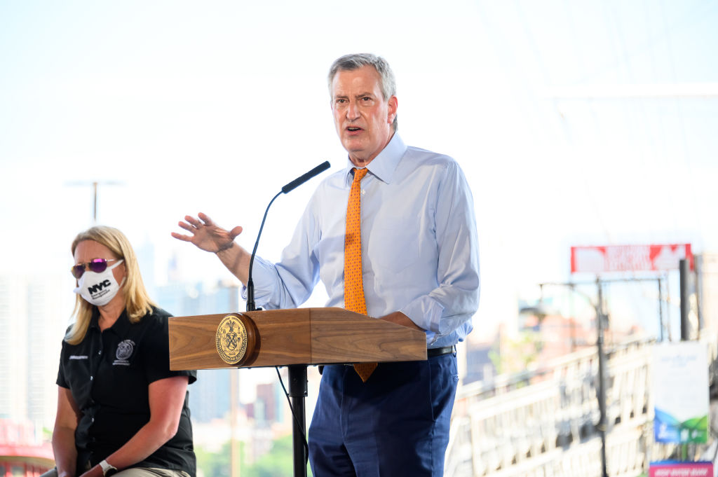New York City Mayor Bill de Blasio speaks at South Street Seaport as workers erect temporary flood barriers in preparation for potential flooding and a storm surge from Tropical Storm Isaias on August 03, 2020 in New York City.