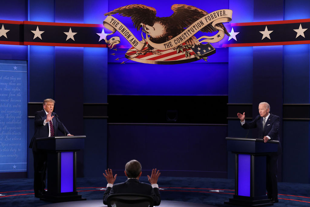 U.S. President Donald Trump and Democratic presidential nominee Joe Biden participate in the first presidential debate moderated by Fox News anchor Chris Wallace (C) at the Health Education Campus of Case Western Reserve University on September 29, 2020 in Cleveland, Ohio.