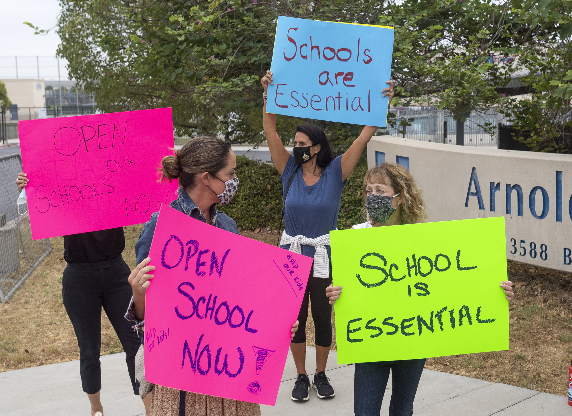 Protesters rally for schools to be reopened for full, in-person instruction outside Beckman High School in Irvine, Calif., on Sept. 8, 2020.