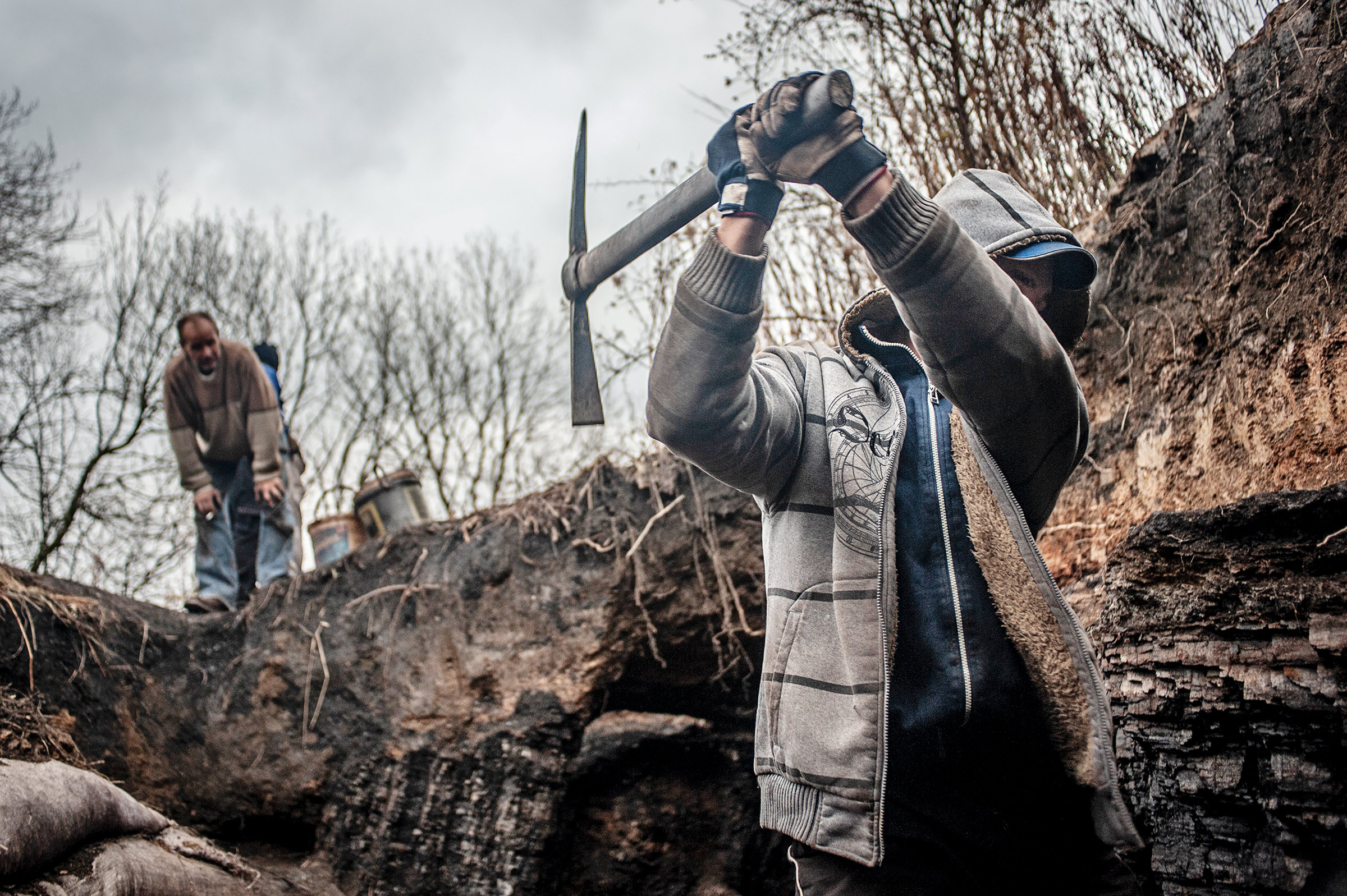 Men illegally mine for coal to be used to heat homes in Walbrzych, Poland, in 2013.