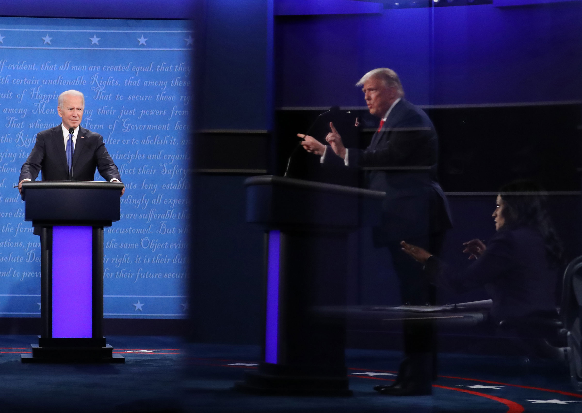 President Donald Trump and Moderator Kristen Welker, seen in a reflection, and Democratic presidential nominee Joe Biden participate in the final presidential debate in Nashville, Tenn. on Oct. 22, 2020.