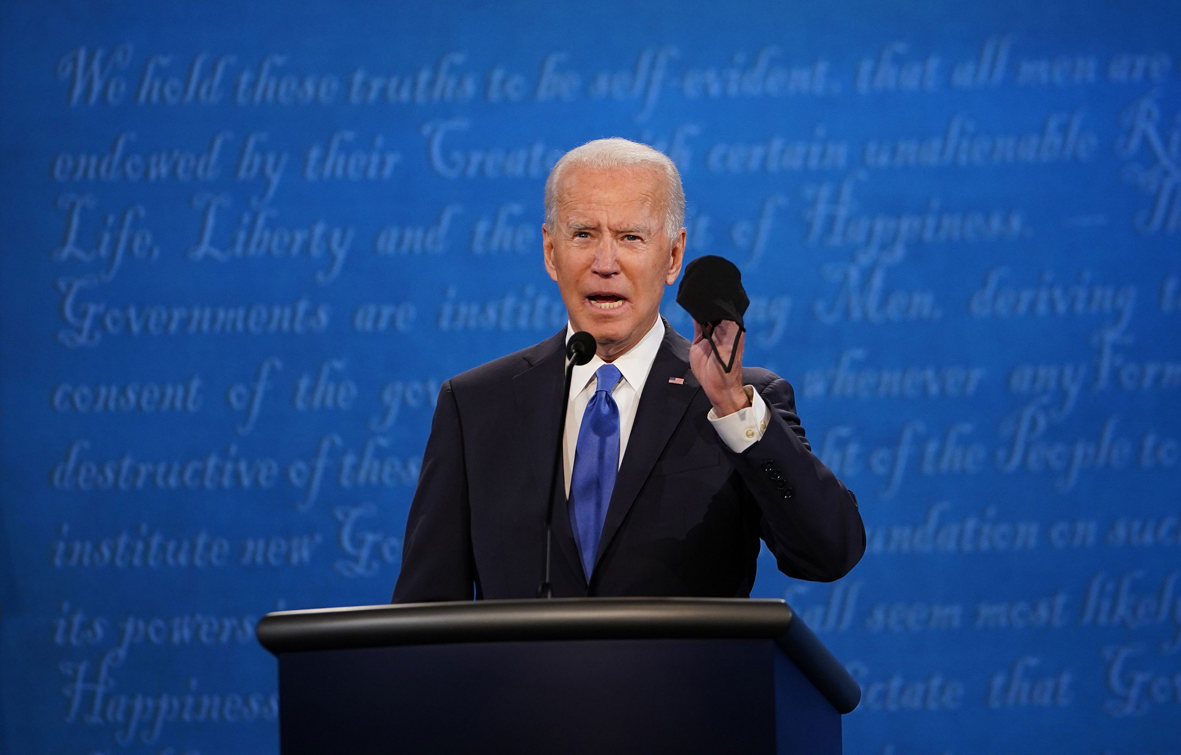 Joe Biden holds up a mask as he speaks during the final presidential debate at Belmont University in Nashville.