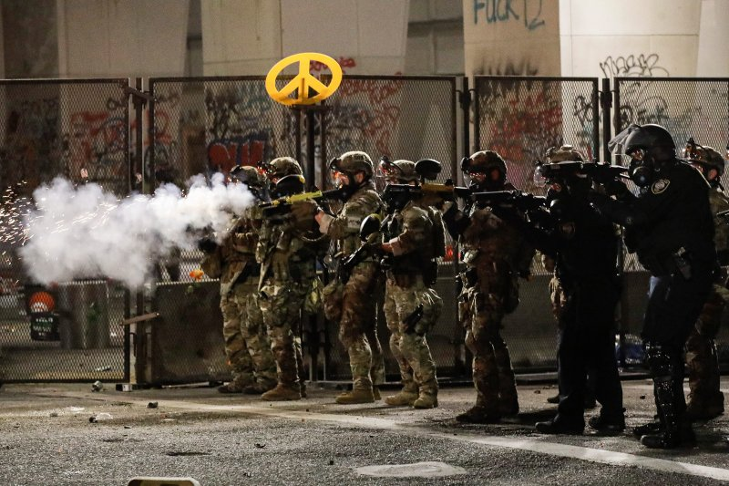 Federal agents use crowd-control munitions to disperse Black Lives Matter demonstrators during a protest in Portland, Ore., on July 24.